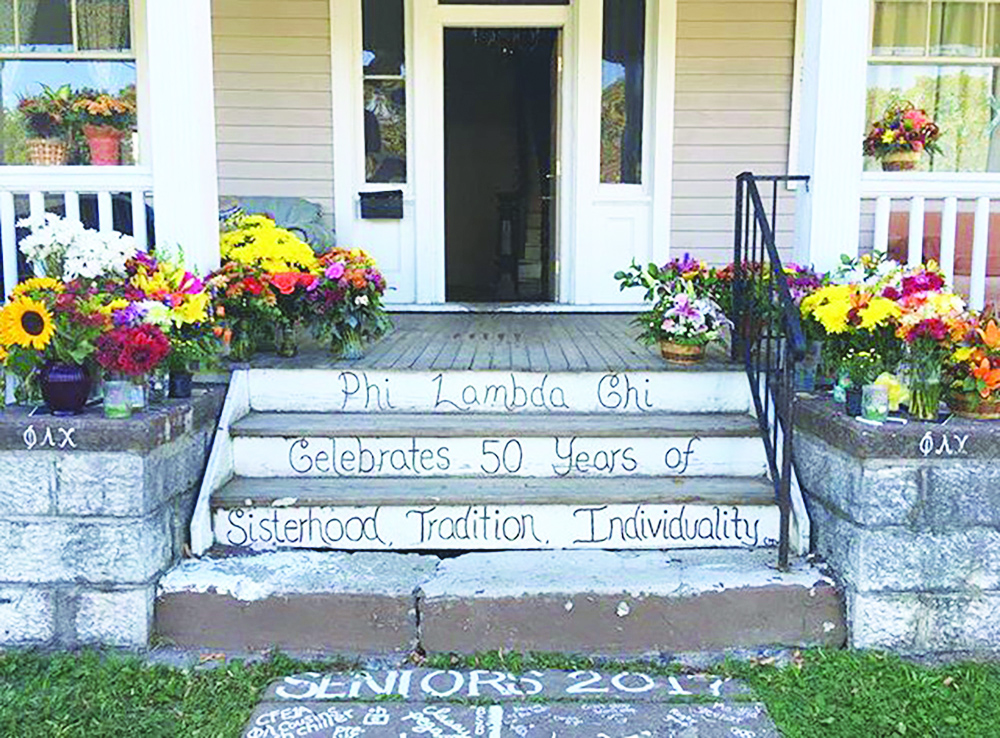 The Phi Lambda Chi house. After Alex's passing, the house was decorated with flowers to commemorate her.