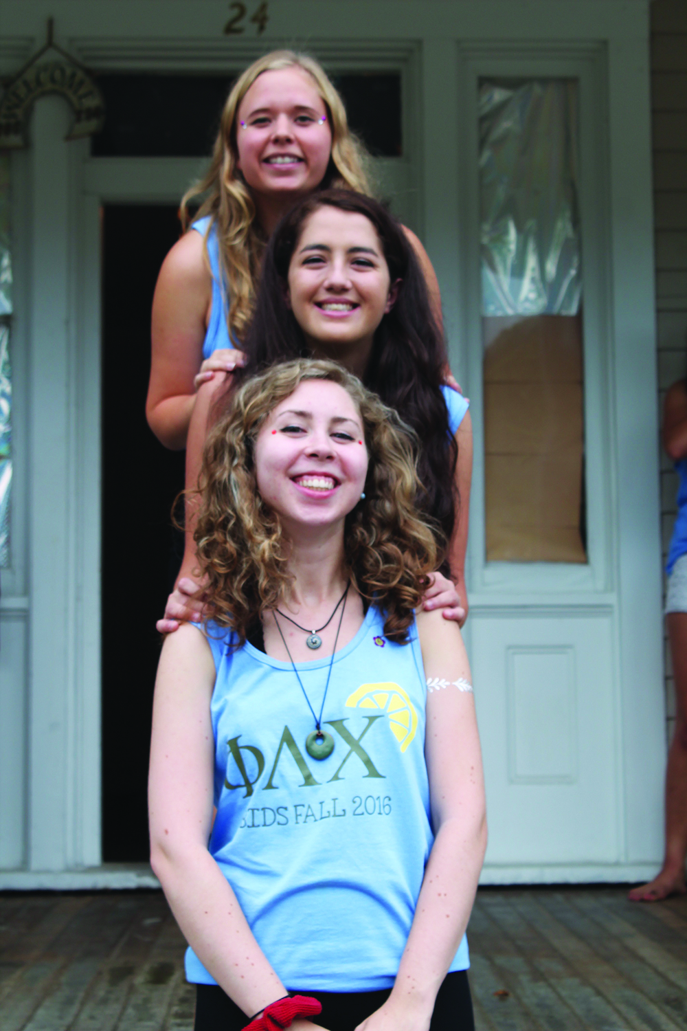 Alex stands happily between her big, Elise Johnson '17, and her little, junior Madeline Walker, for a Phi Lambda Chi family photo.