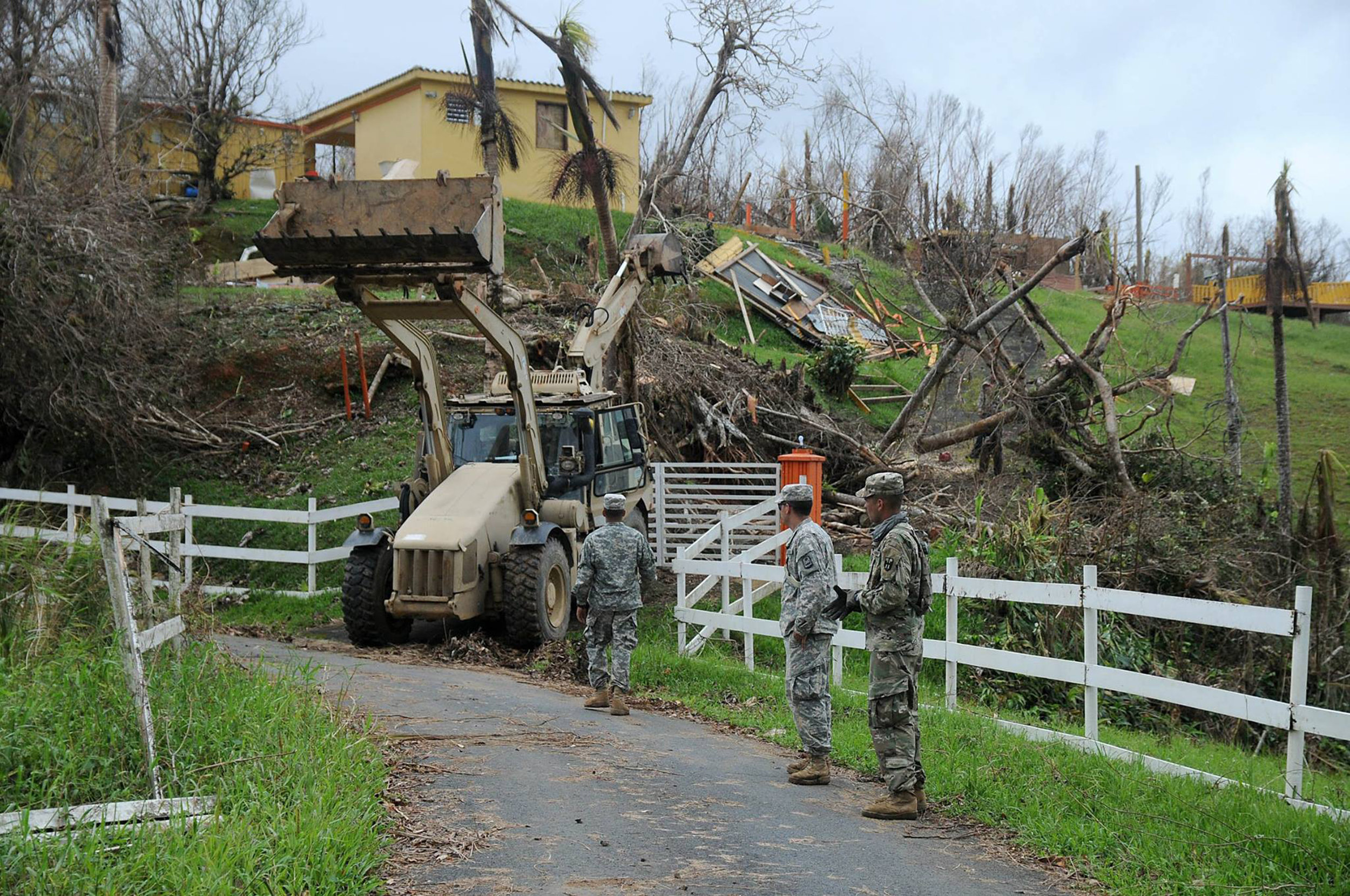 Members of the Puerto Rico Army National Guard are (pictured above) clearing an area in the municipality of Cayey, following Hurrricane Maria's destruction. The SUNY system has decreased the tuition that Puerto Rican and Virgin Islander students will have to pay in order to mitigate their financial difficulties. (Wilma Orozco/Creative Commons)