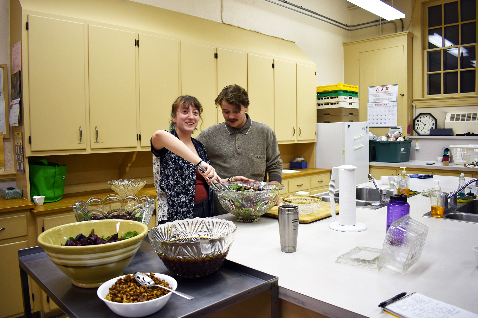 Theater major junior Lila Klatz (pictured left) and English major senior Nolan Parker (pictured right) preparing for the fall community dinner in the Central Presbyterian Church kitchen on Saturday Nov. 4. The dinner also featured a coat drive for migrant workers. (Izzy Graziano/Knights' Life Editor)