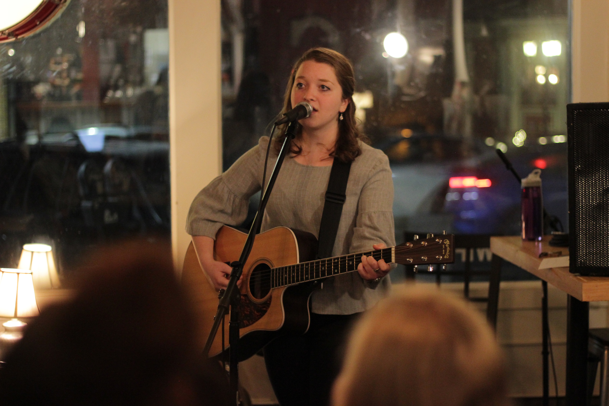 Pictured above is communication major senior Allison Leah, who performed alongside the band Straw Hat at Cricket's Coffee Company on Thursday Feb. 1. Straw Hat includes vocalist senior Jennifer Bender, drummer sophomore Marty Bezinger and guitarist Noah Ellis, who is a student at Monroe Community College. (Mike Wall/Staff Photographer)
