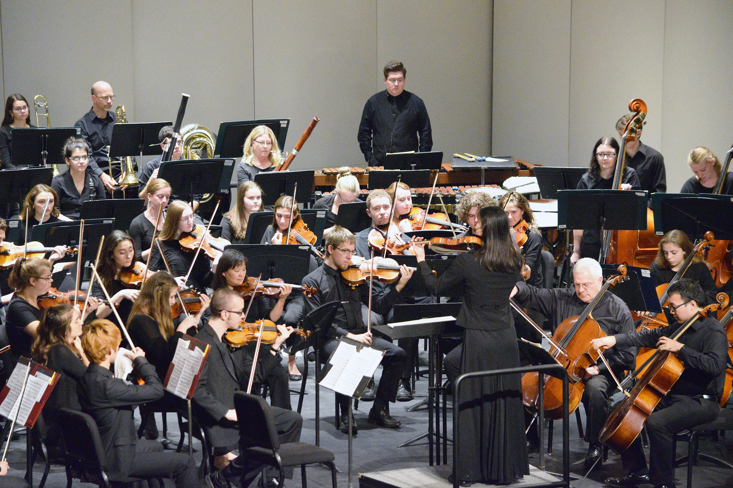 The Geneseo Symphony Orchestra performed on Sunday Oct. 14 in Wadsworth Auditorium. Leah McGray conducted the orchestra as they played a multitude of pieces by composers such as Franz Schubert, professor of music James Walker and Edvard Grieg. (Elijah Reed/Staff photographer)