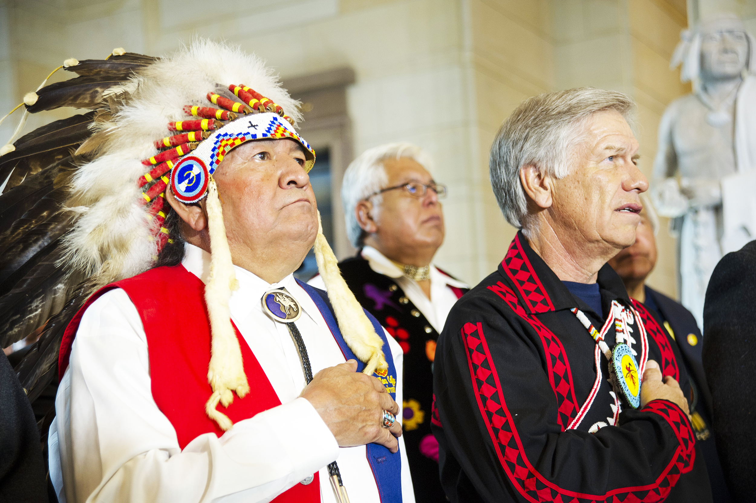 Wallace Coffey, Chief of the Comanche Nation of Oklahoma (left) and Choctaw Nation of Oklahoma Chief Gregory Pyle (right) stand during a ceremony in which their tribal citizens were honored with an award. North Dakota's new law will wrongly rob Native Americans of their voting rights (U.S. Army Staff Sgt. Sean K. Harp/creative commons).