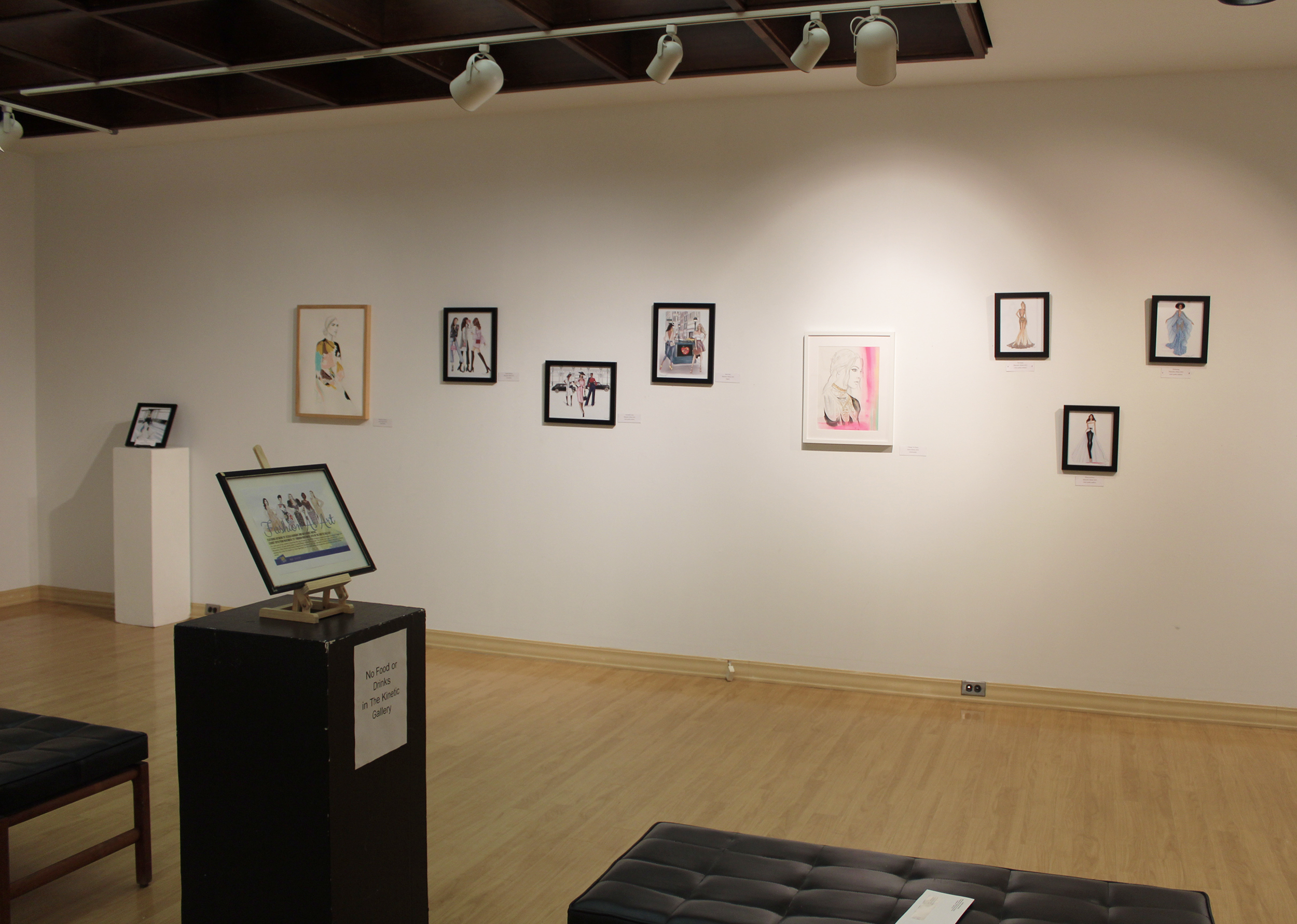 """The """"Fashion as Art"""" exhibit in the Kinetic Gallery (pictured above) opened on Thursday Nov. 1. This collection of illustrations shows fashion can be a form of creative expression (Catherine White/ Editor-in-chief)."""