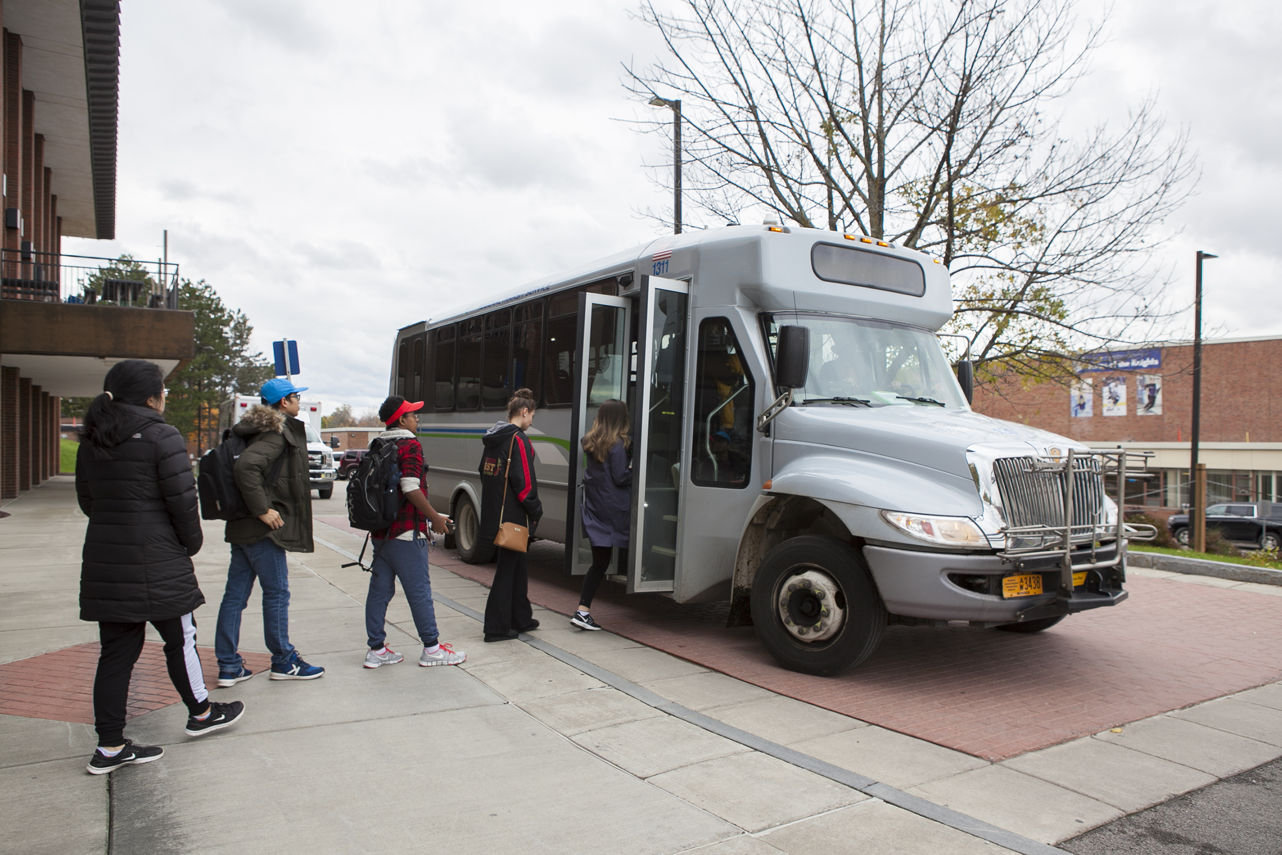 Students boarding a local bus (pictured above) that goes to various locations on and off-campus during the academic year, including Walmart and Wegmans. Communications major senior Udeshi Seneviratne, an international student from Vietnam, started a Geneseo Speaks petition calling for the college to offer transportation to students staying on campus during breaks (Udeshi Seneviratne/photo editor).