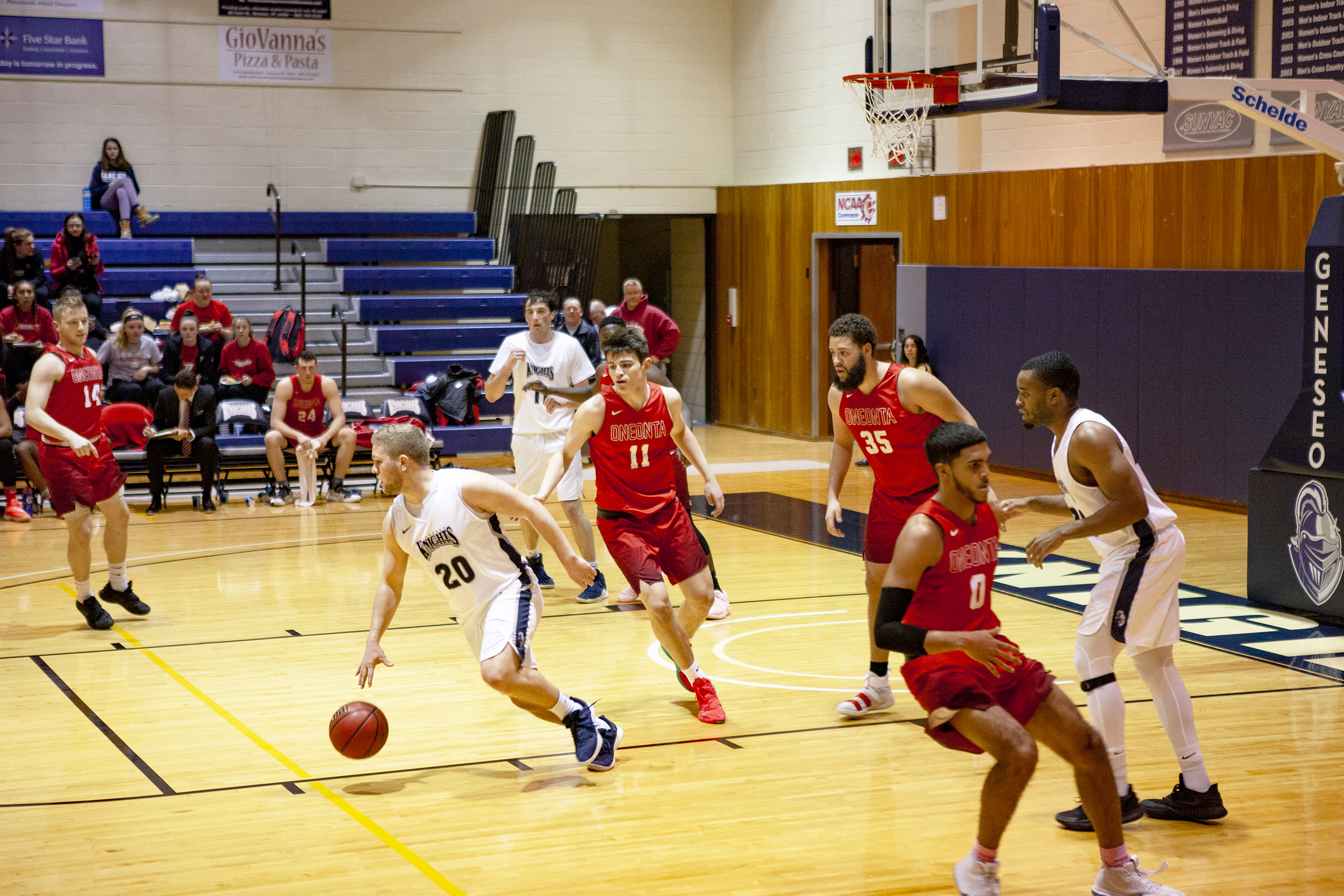 Senior guard Zack Panebianco pushes the ball up the court in the team's game against SUNY Oneonta. Panebianco scored 23 points off the bench in the team's 89-77 loss to the Red Dragons on Friday Feb. 1 (Udeshi Seneviratne/Photo Editor).