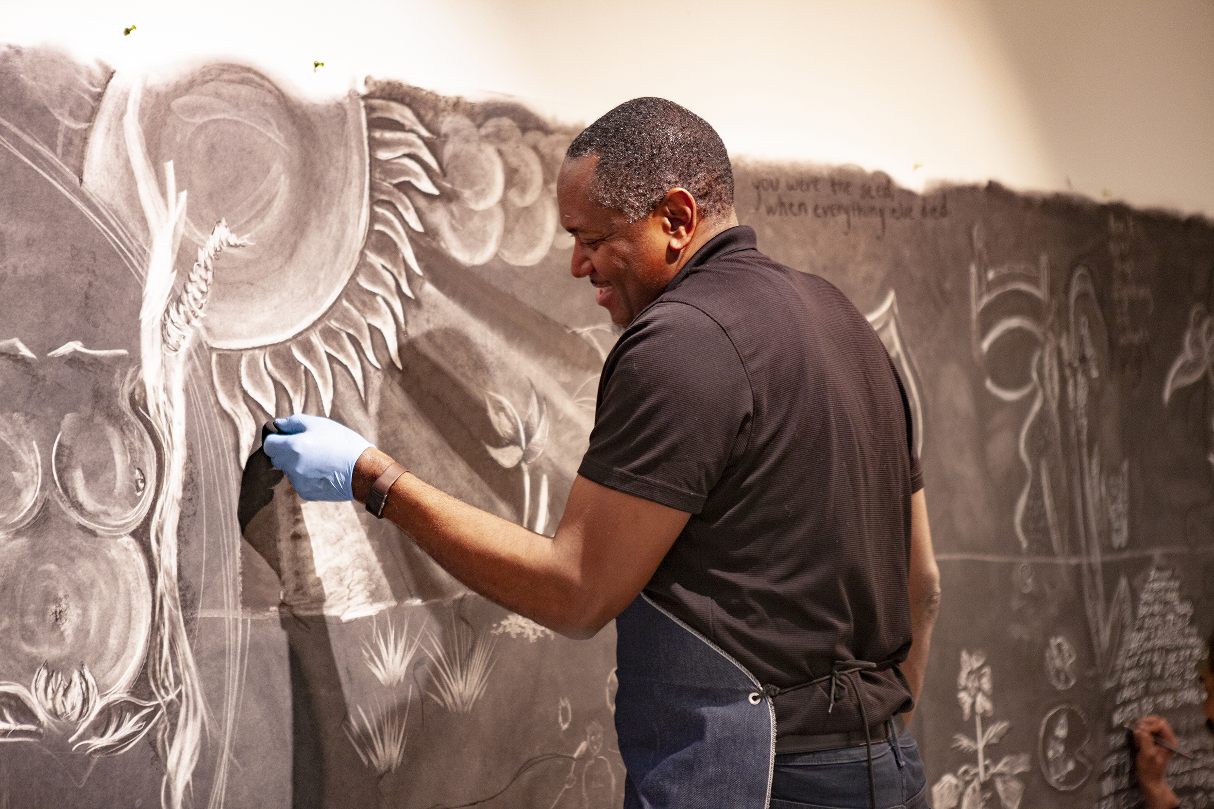 """Artist Steve Prince (pictured above) has helped Geneseo students channel their strife with the world through art with his """"Urban Garden"""" exhibit in the Kinetic Gallery. Prince also presented """"Sankofa: Hope of Renewal, the art of Steve Prince"""" in the Bertha V.B. Lederer Gallery (Udeshi Seniveratne / Photo editor)."""