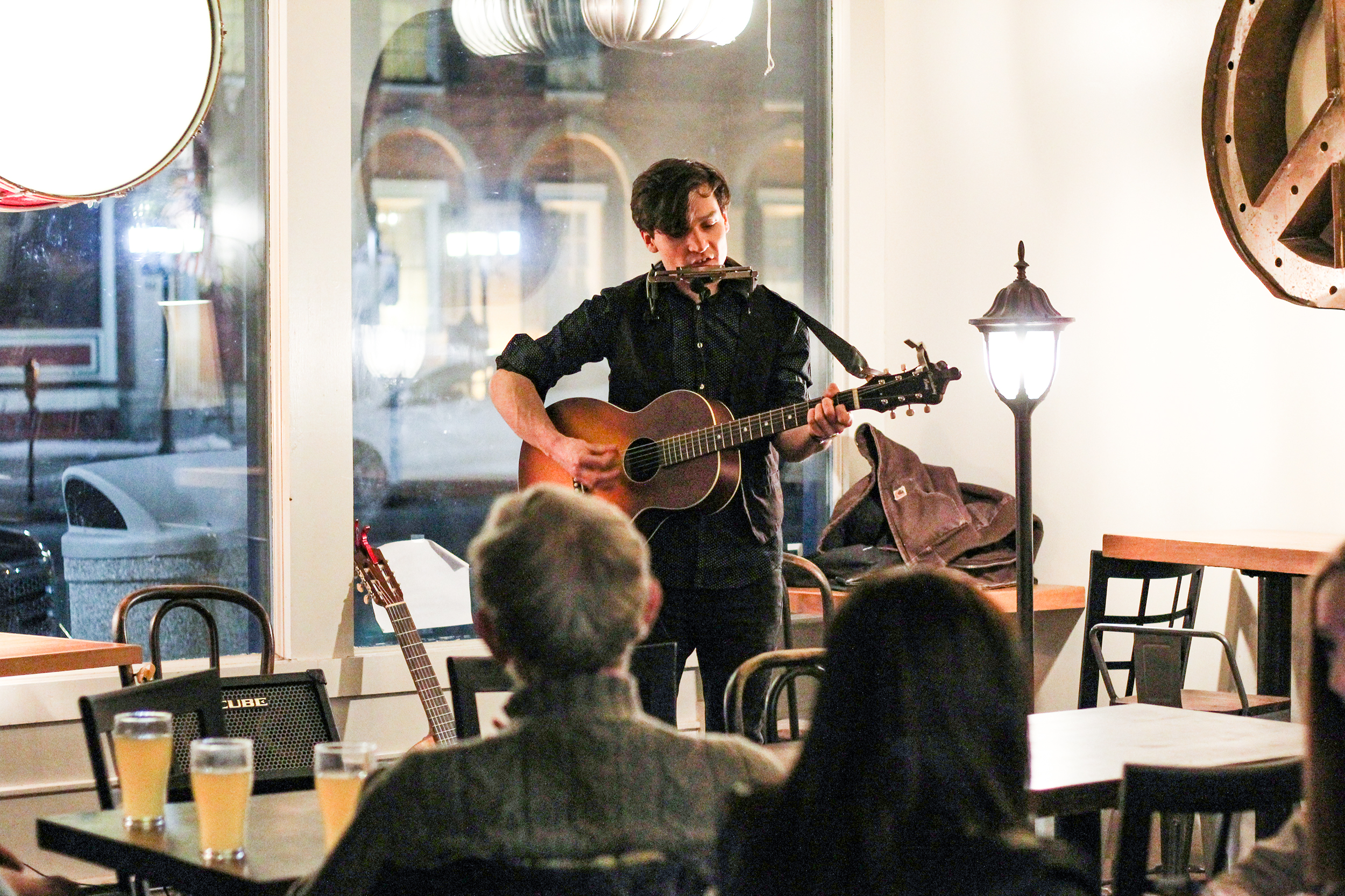 Jackson Cavalier (pictured above) performed at Crickets Coffee Company on Main Street on Thursday Feb. 21. Cavalier sings and plays instruments by himself to produce his folk music (Catherine White/editor-in-chief).
