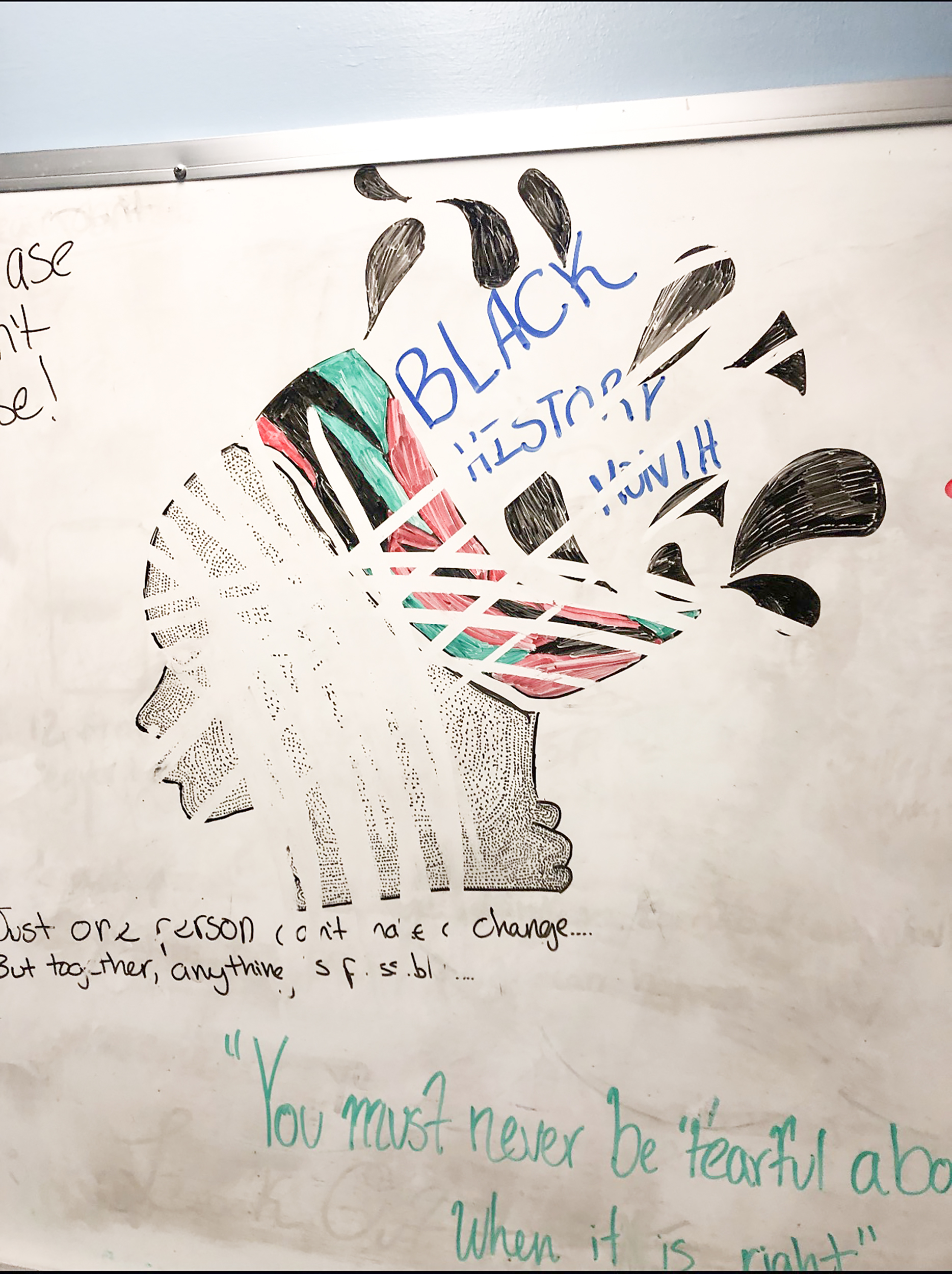 """A resident assistant in Niagara Hall decorated a whiteboard with a drawing for Black History Month (pictured left) that was then erased by an unknown person (pictured right). One gender-neutral bathroom was also vandalized with the words,""""men only""""(Courtesy of niagara hall resident)."""