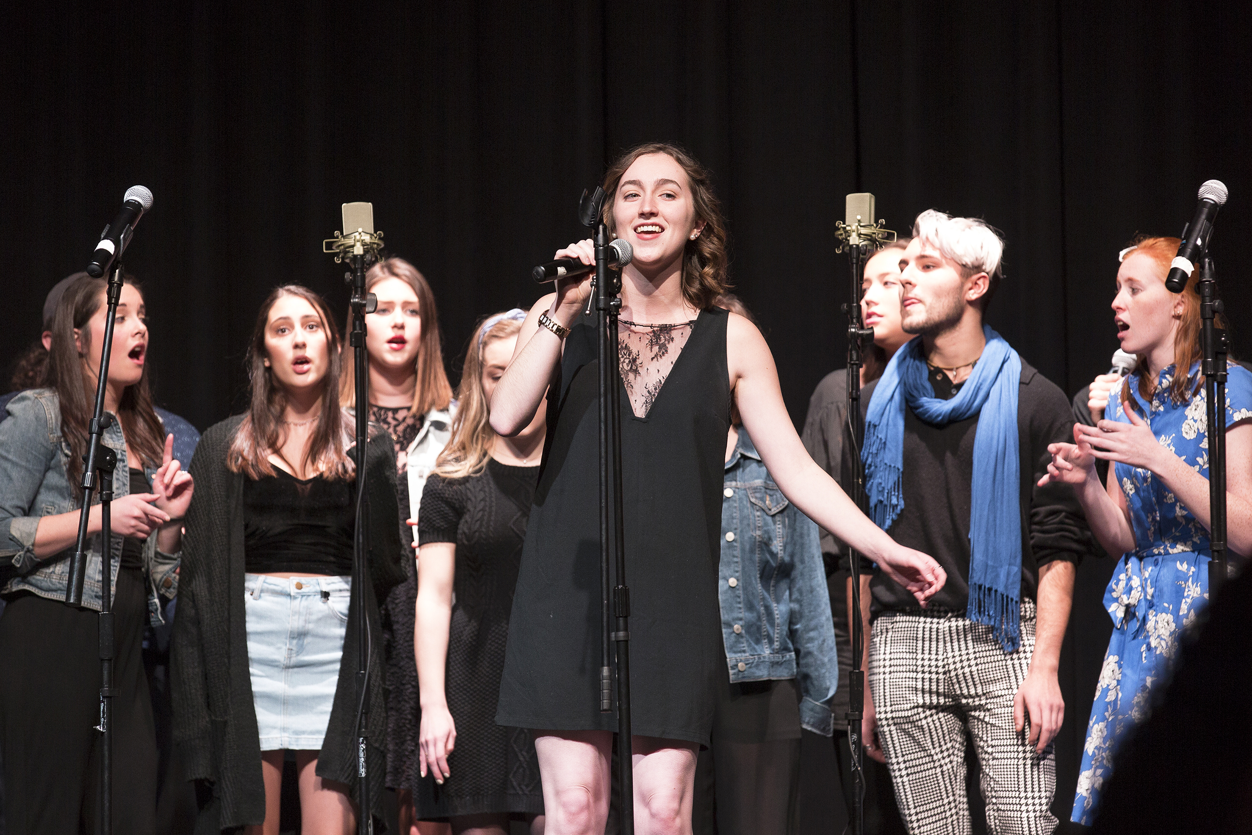Communication major senior Gabrielle Owen (pictured above) sings with Between the Lines at the fall invitational hosted by BTL and Emmelodics on Nov. 9. Owen maintains a passion for music as president of BTL (Annalee Bainnson/staff photographer).
