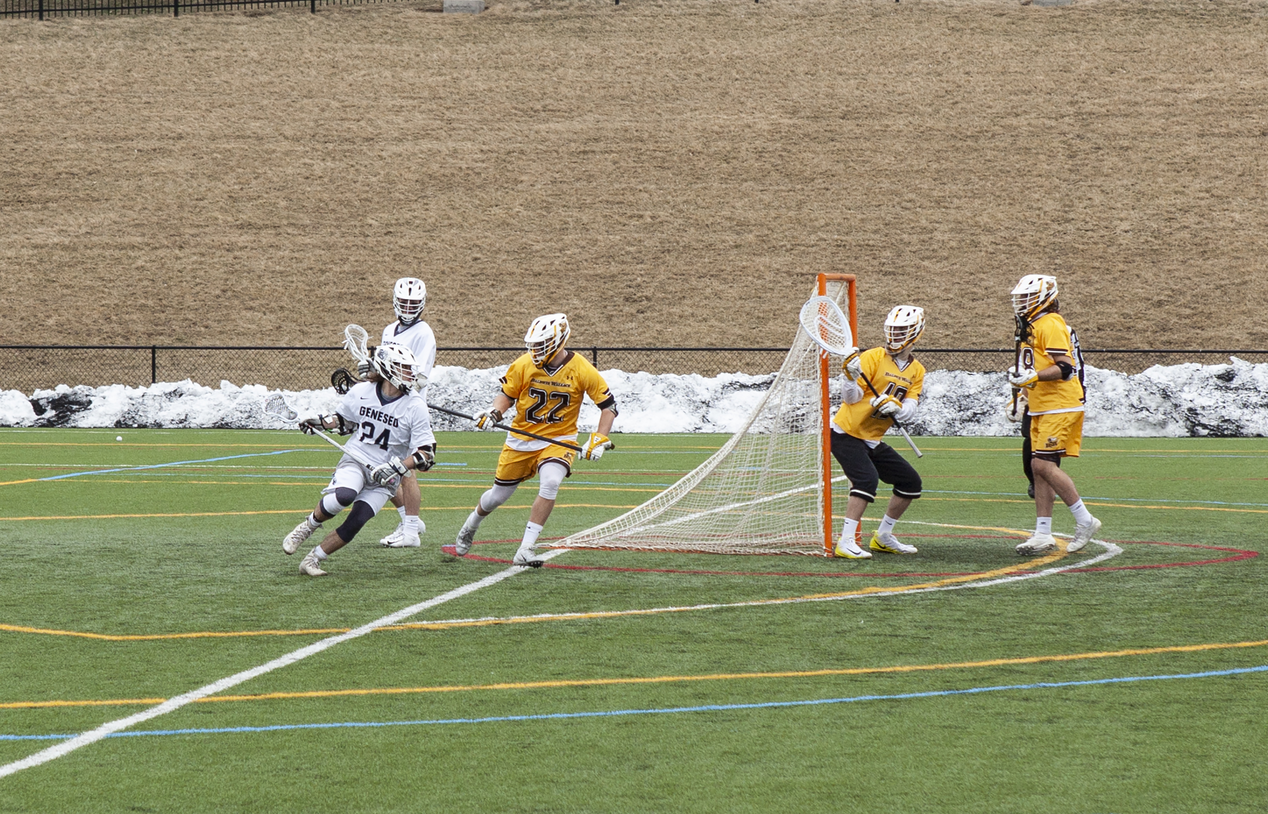 Junior attacker Patrick Morris carries the ball behind the Baldwin Wallace Yellowjackets' goal in the team's game on Wednesday March 13. Geneseo lost to the Yellowjackets 13-10 (Udeshi Seneviratne/Photo Editor).