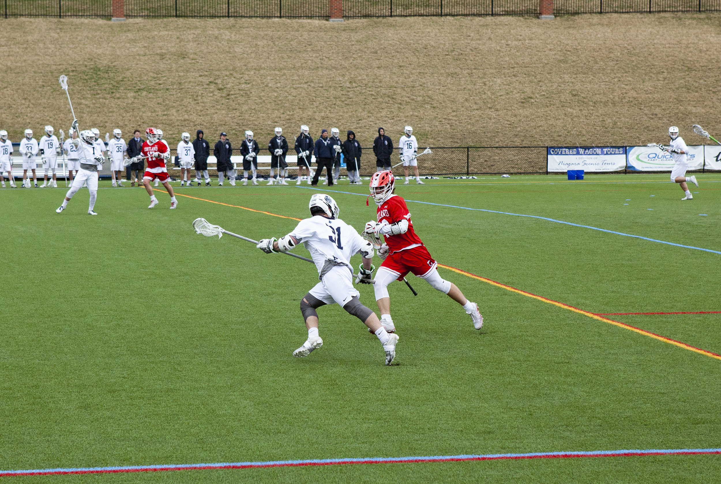 Senior defender Jack Crowley (pictured above) takes on an opposing attacker in a game against SUNY Cortland on Wednesday April 10. Geneseo lost 13-11 to the top-ranked team in the conference (Udeshi Seneviratne/Photo Editor).