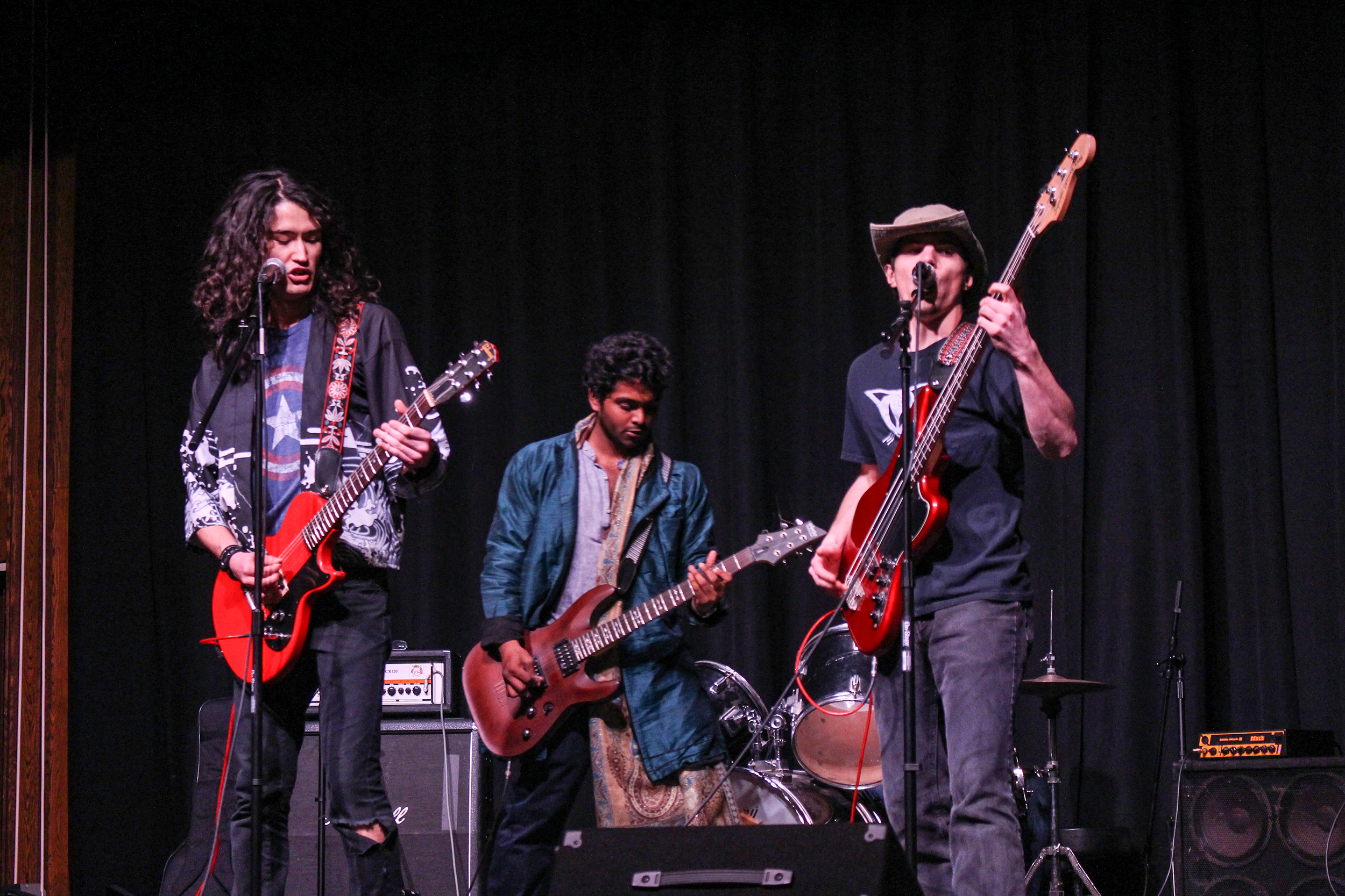 The band Scarecrow Show, including members communication major senior Vincent Lema (pictured left) and Ben Juchniewicz '18 (pictured right), performed at the Battle of the Bands on Thursday April 11 with guest musicians like physics major senior Praveen Wakwella (pictured center). Scarecrow Show performed alongside Shades of Nance, Airline Food, Crustacean Weekend and solo singers junior history major Toby Youngman and first-year Maya Cottone (Annie Renaud/ staff photographer).