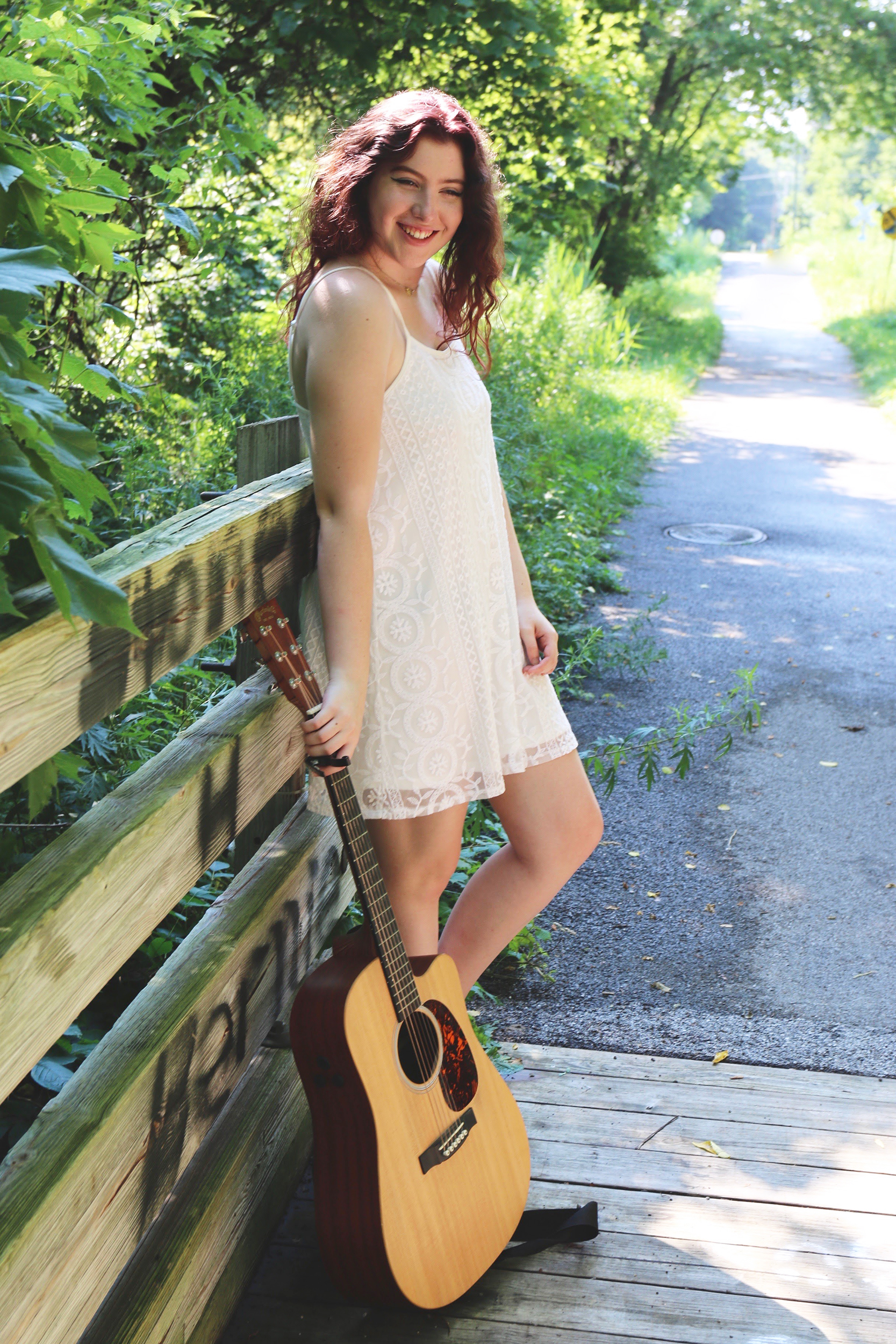 English creative writing major freshman Katherine Johnson (pictured above) writes music and poetry in her spare time. Johnson plays guitar and sings her own songs along with covers at open mic nights. She hopes to produce an EP in the summer of 2019 (courtesy of Katherine Johnson).
