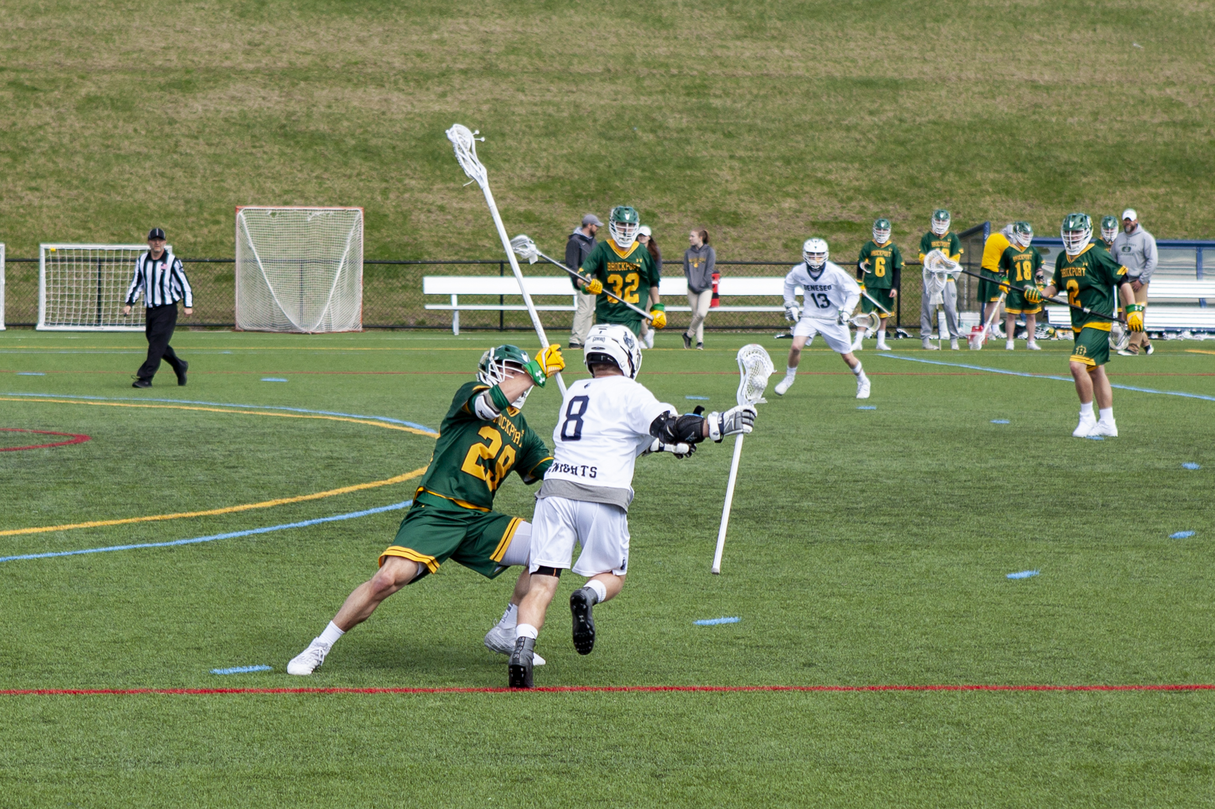 Sophomore midfielder James Pratt (pictured above) makes a move around a SUNY Brockport defender. Pratt had two goals and one assist in the 12-5 victory over Brockport (Udeshi Seneviratne/Photo Editor).