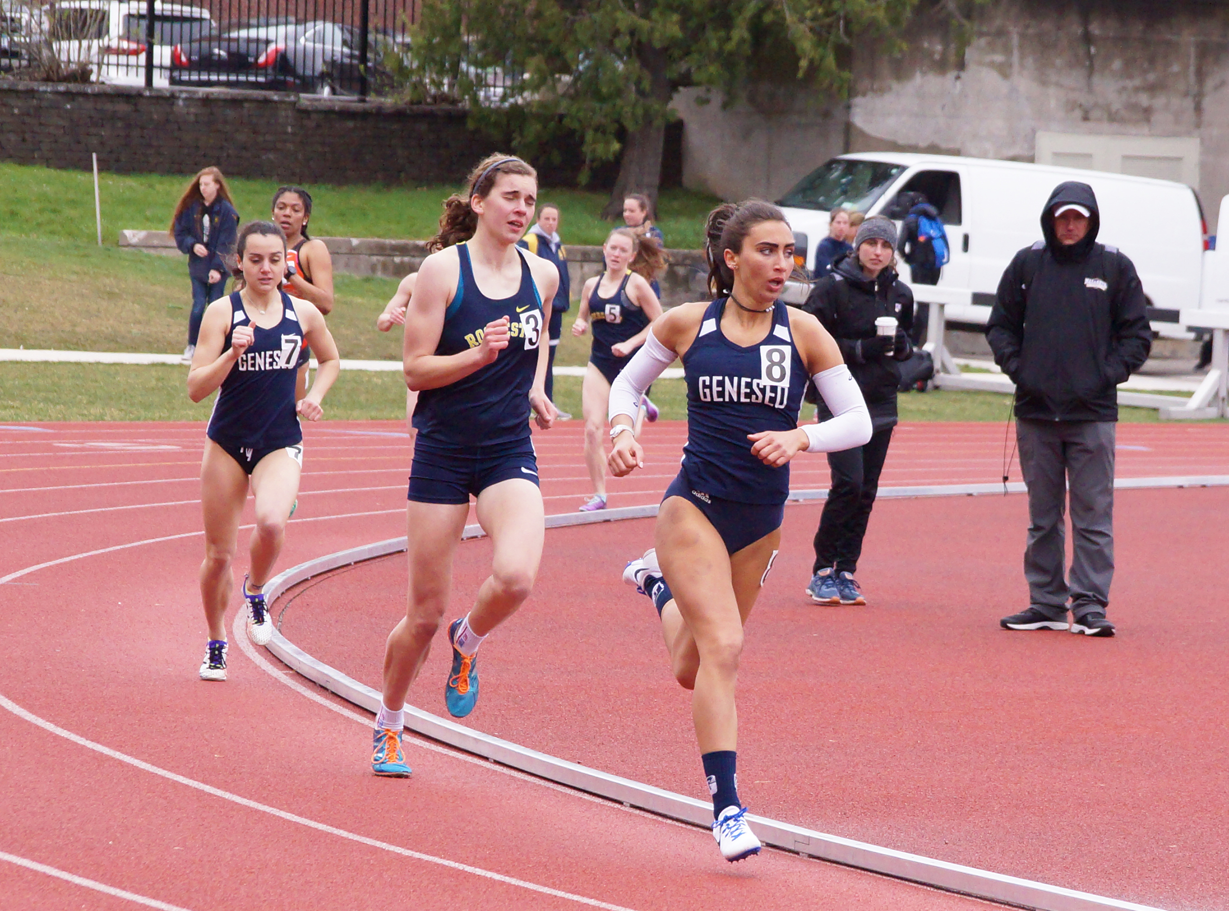 Sophomore sprinter Angela Calabrese (left) and senior mid-distance runner Julianna Lauricella (right) compete in the open 800 at the Rochester Spring Classic. Lauricella placed fifth in the event (Kara Burke/News Editor).