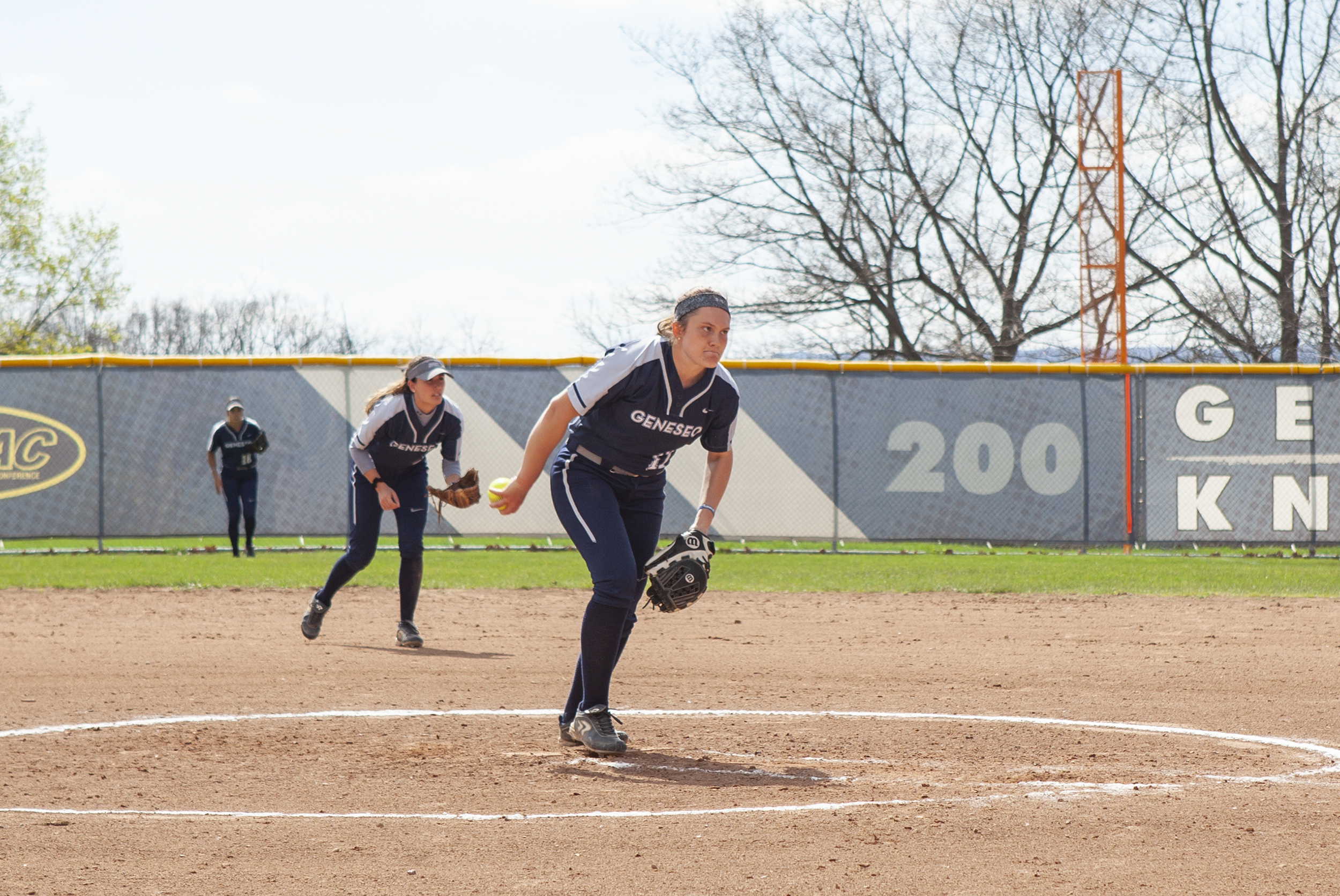 Sophomore pitcher Nicole Schwartz (pictured above) winds up for a pitch against the University of Rochester on Wednesday April 24. Geneseo defeated Rochester in both games of the doubleheader (Udeshi Seneviratne/Photo Editor).