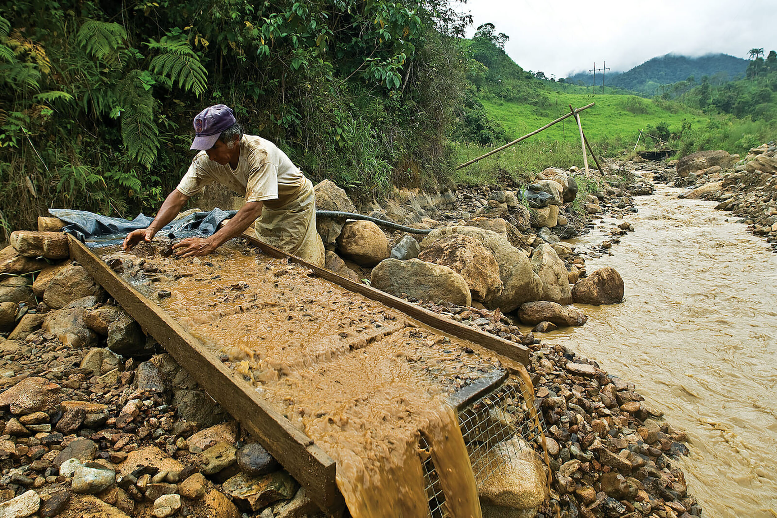 Illegal mining in South American countries such as Columbia (pictured above) have increased to fulfill large companies' necessity for gold and precious metals. Their conditions are often dangerous, abusive and harmful to the environment. (Knut-Erik Helle/wikimedia commons)