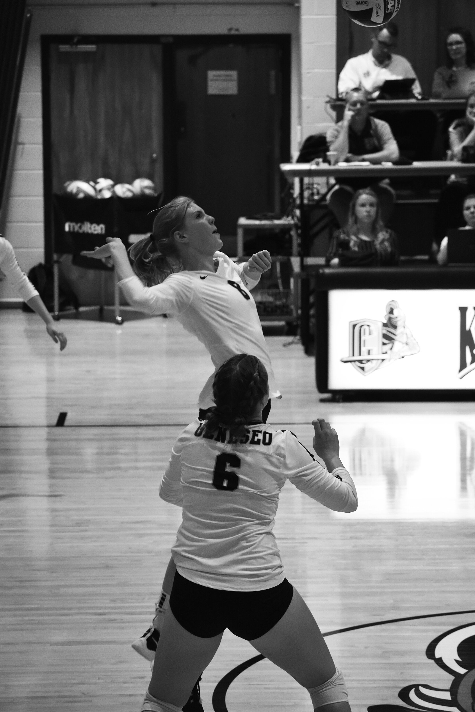 Junior middleblocker Allison Wick goes up to high point the ball as sophomore setter Morgan Michalski looks on. Wick had nine kills over the weekend during the Knights' trip to Pittsburgh (Jenna Smolinski/ Staff Photographer).