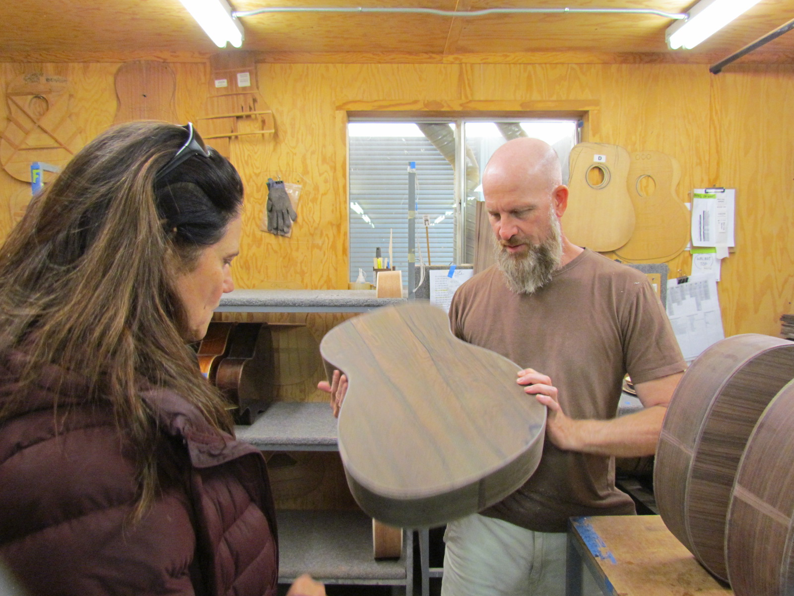 Jean from Larivee Guitar shows me (Nic) the cool woods that make these guitars exceptional. (I already knew that which is why I play them, but I loved hear about the intricacies of these fine instruments!)