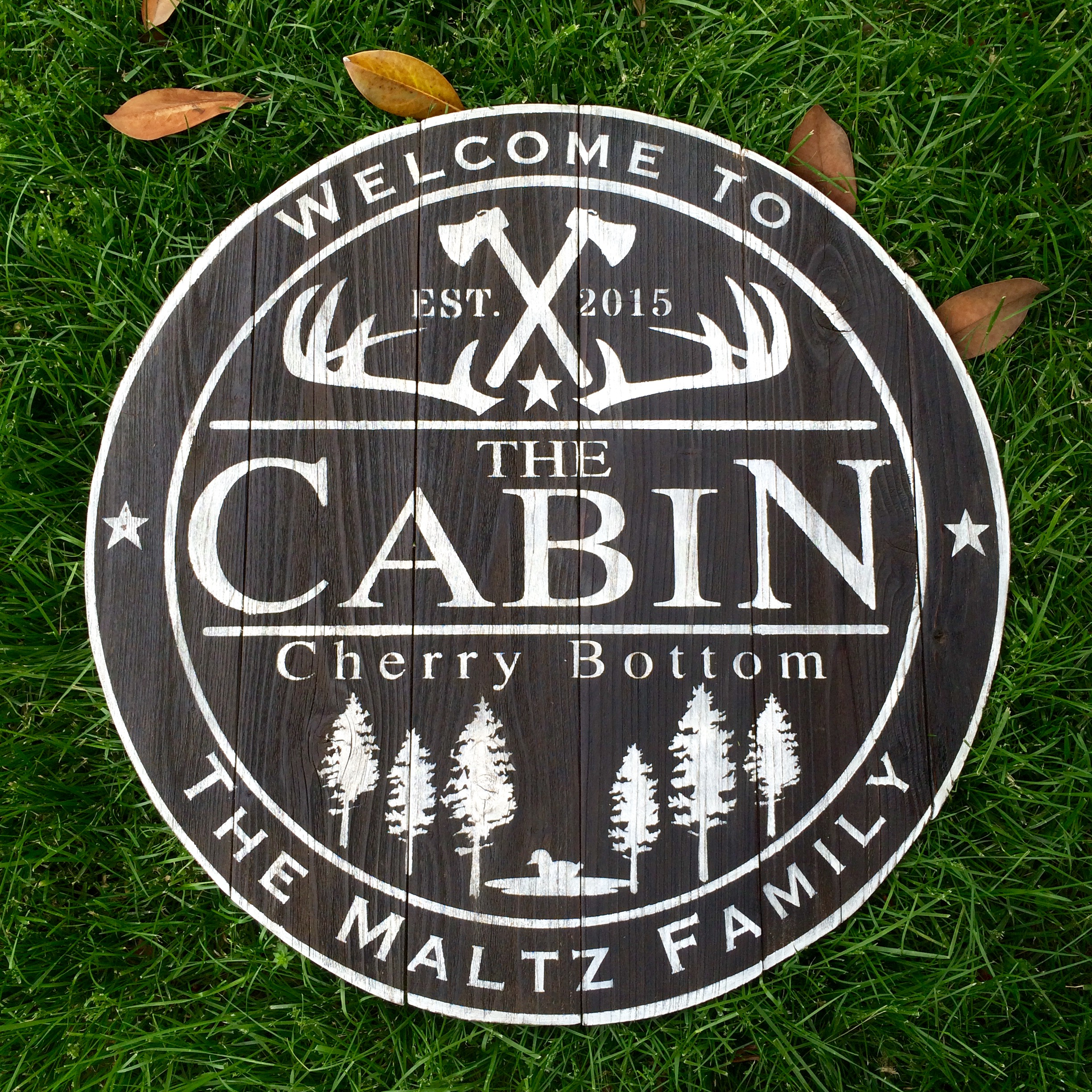 """dark brown with custom white lettering and images 32"""" across"""
