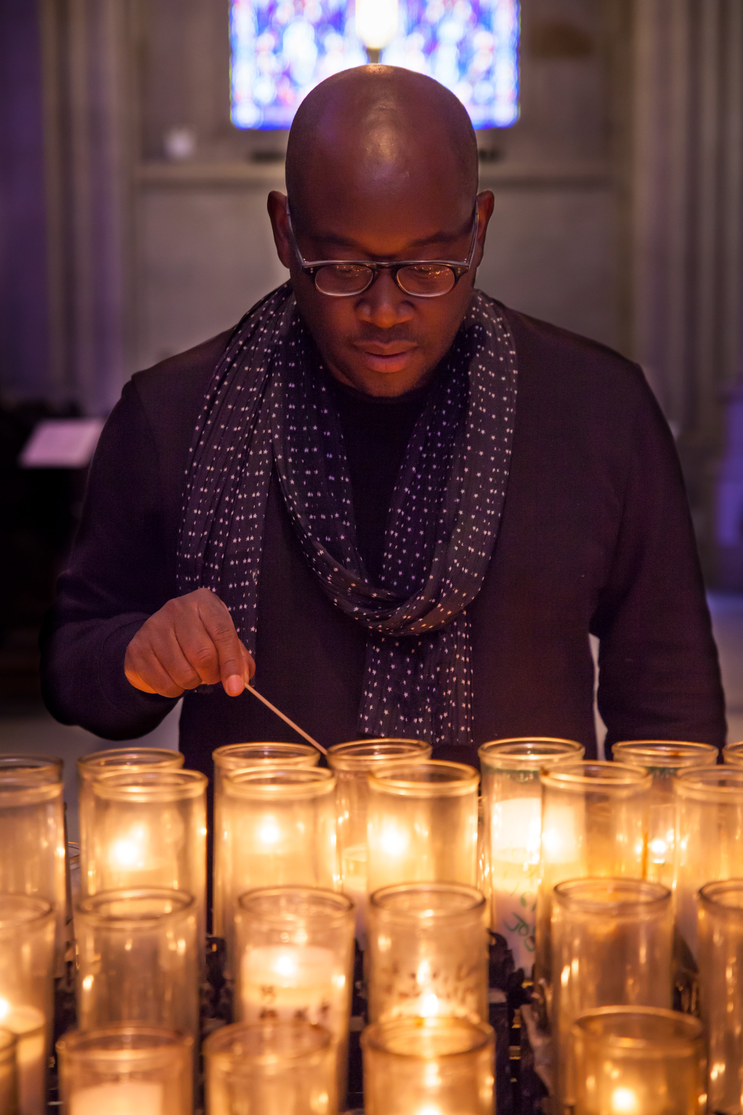 Sedrick with candles at St. John the Divine