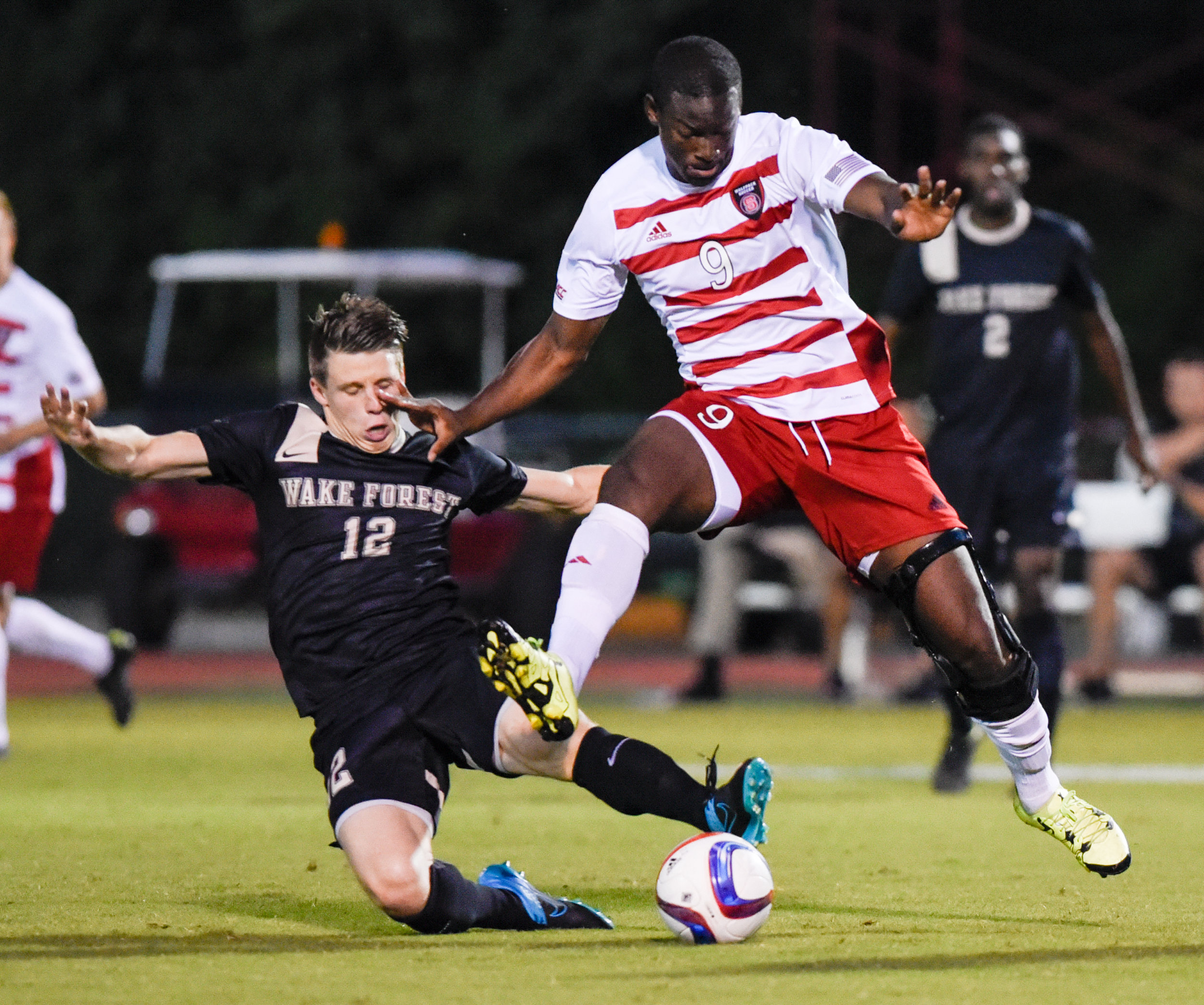 NC State's Ade Taiwo (right, 2) , battles against Wake Forest's Brad Dunwell (left 12), on October 9, 2015