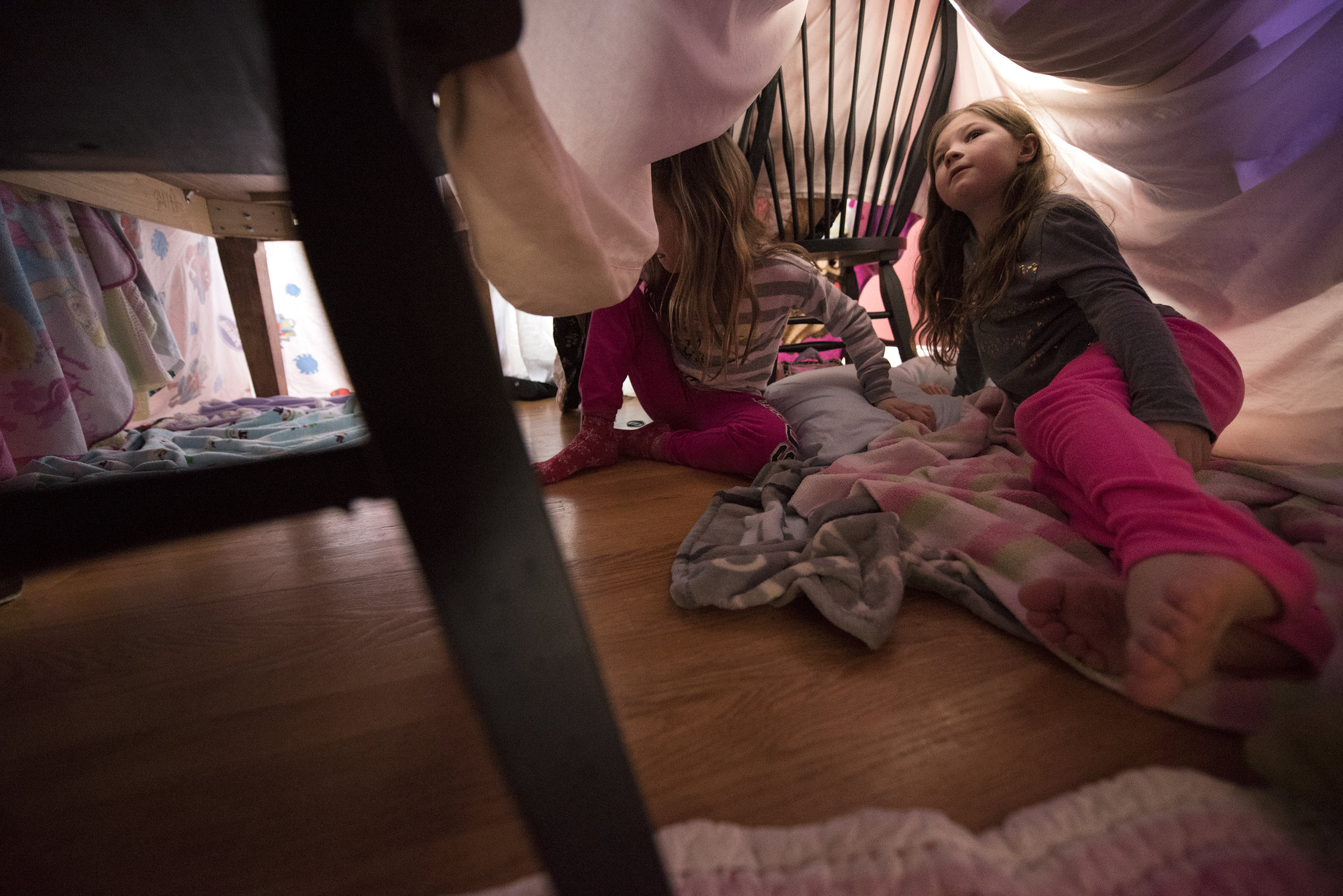 Sophie Wade, 7, right, looks up into her fort as sister Ava, 9, heads toward the kitchen of the fort inside their Henderson home on Tuesday, January 10, 2017.