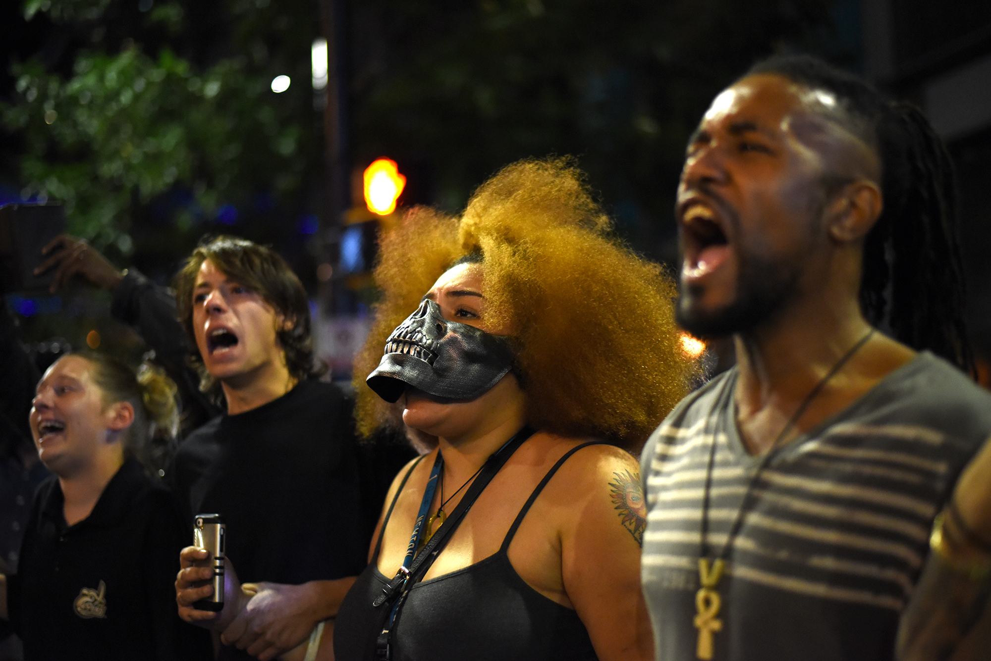 Protesters confront riot police officers in Charlotte, North Carolina, USA, 21 September 2016. North Carolina governor Pat McCrory declared a state of emergency after protesters took to the streets of Charlotte, North Carolina, for the second consecutive night to demonstrate against the fatal shooting of African-American Keith Lamont Scott by police officers.