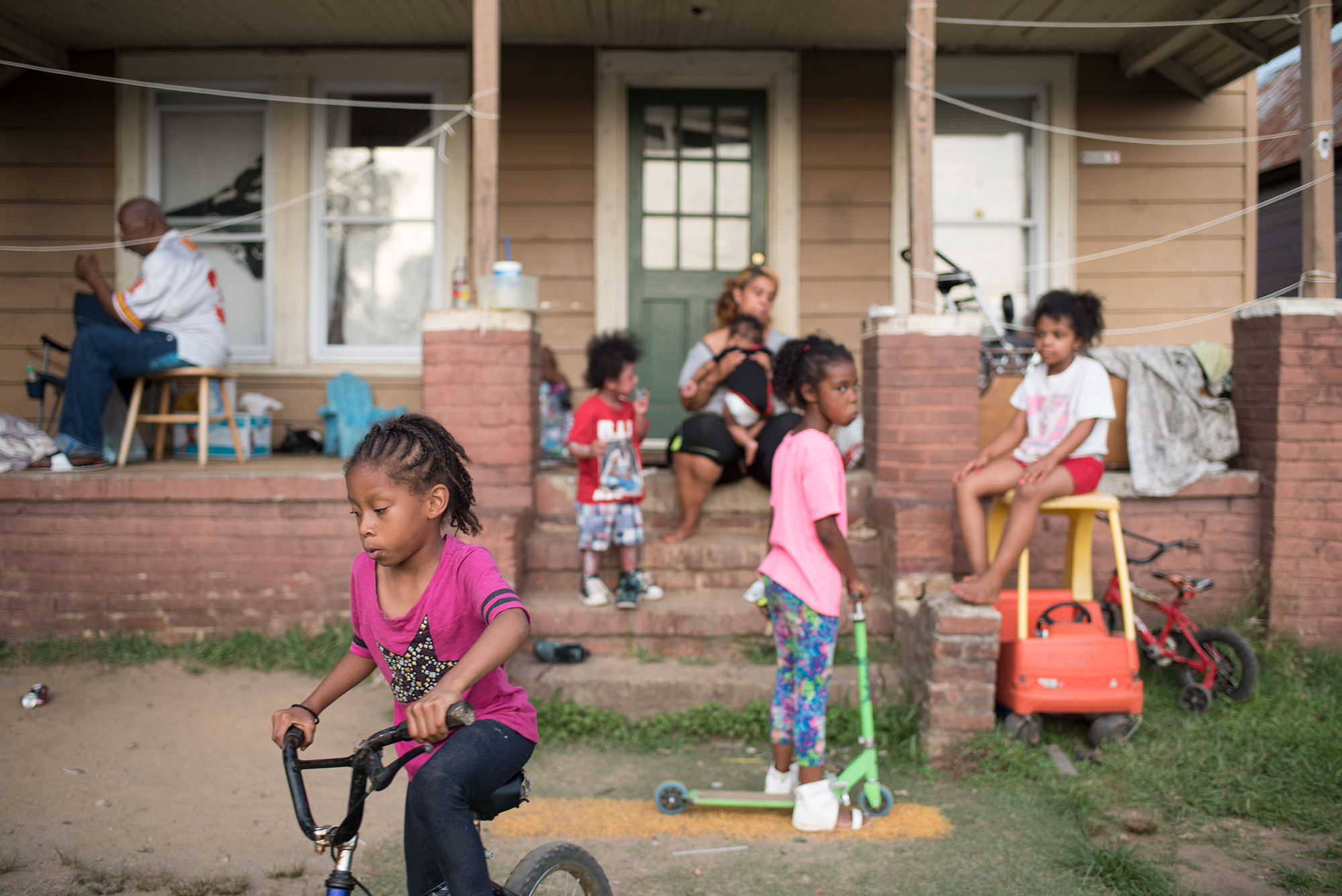 Mother Charise Henderson, sits on the steps with her kids in Raleigh, North Carolina. Henderson has a son, Za'Mont, 5, who has Sickle Cell Disease and has had three liver transplants over the course of three years.