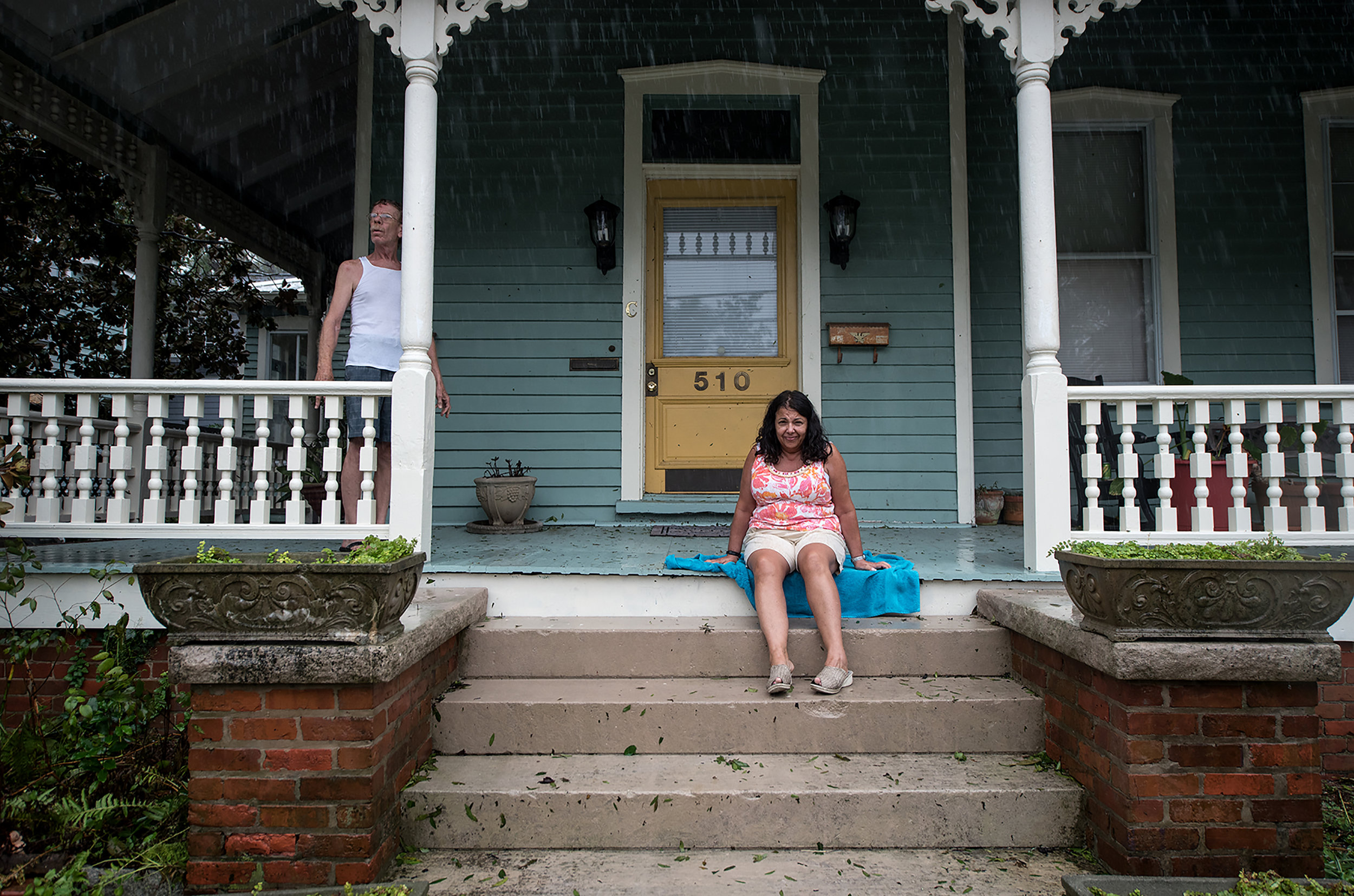 "J.R. Simons (left), homeowner of 510 Dock Street, stands with tenant Cathy Sullivin in Wilmington, North Carolina, September 15, 2018. ""From my understanding this is a higher elevation part of Wilmington. And the most dangerous part of the storm would be the storm surge and that was down by the River."" Sullivin said. Sullivin moved to Wilmington from Boston in 2017."