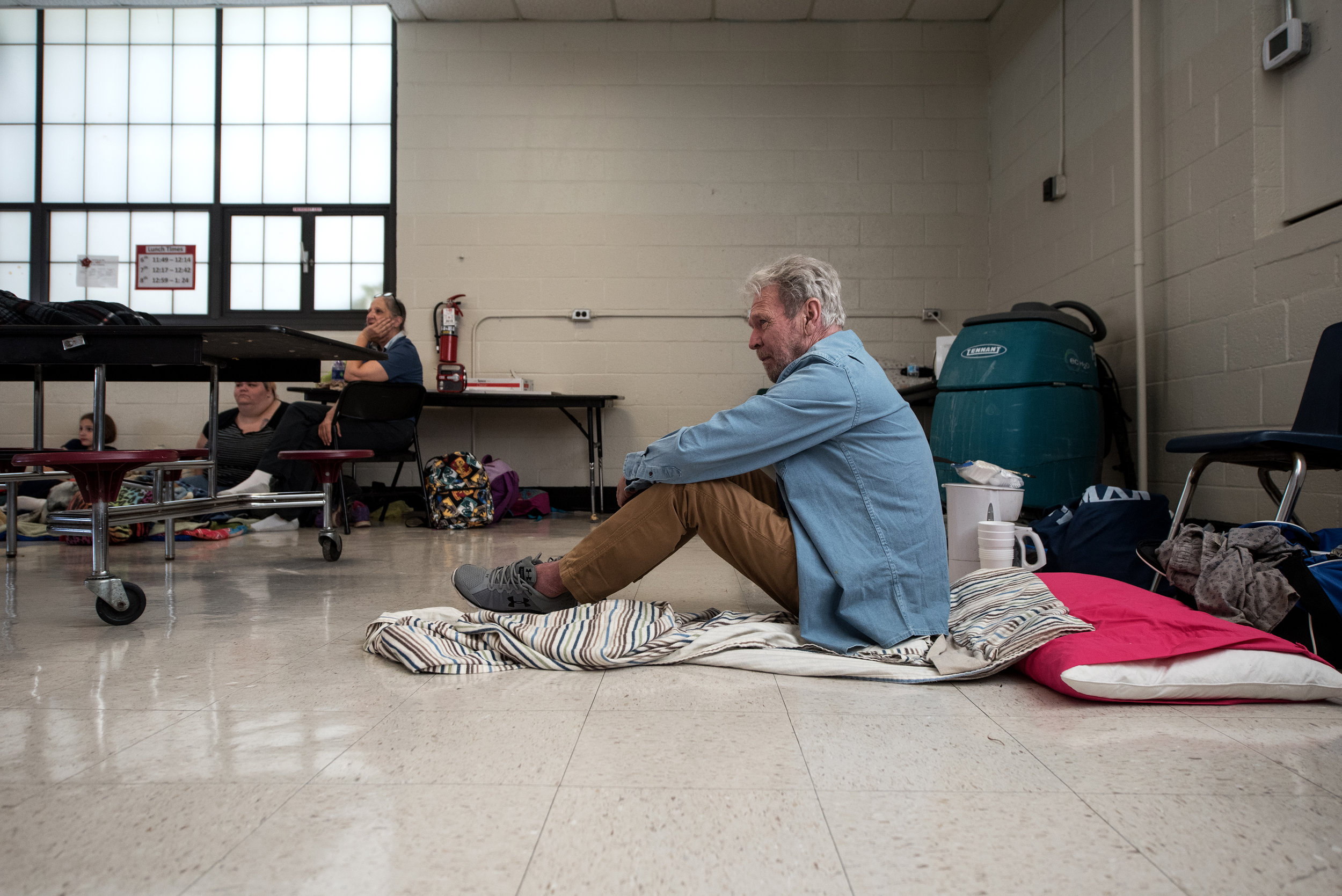 Patrick Russell sits in Burgaw Middle School as he seeks shelter ahead of the forecasted landfall of Hurricane Florence in Burgaw, North Carolina, USA, 12 September 2018.