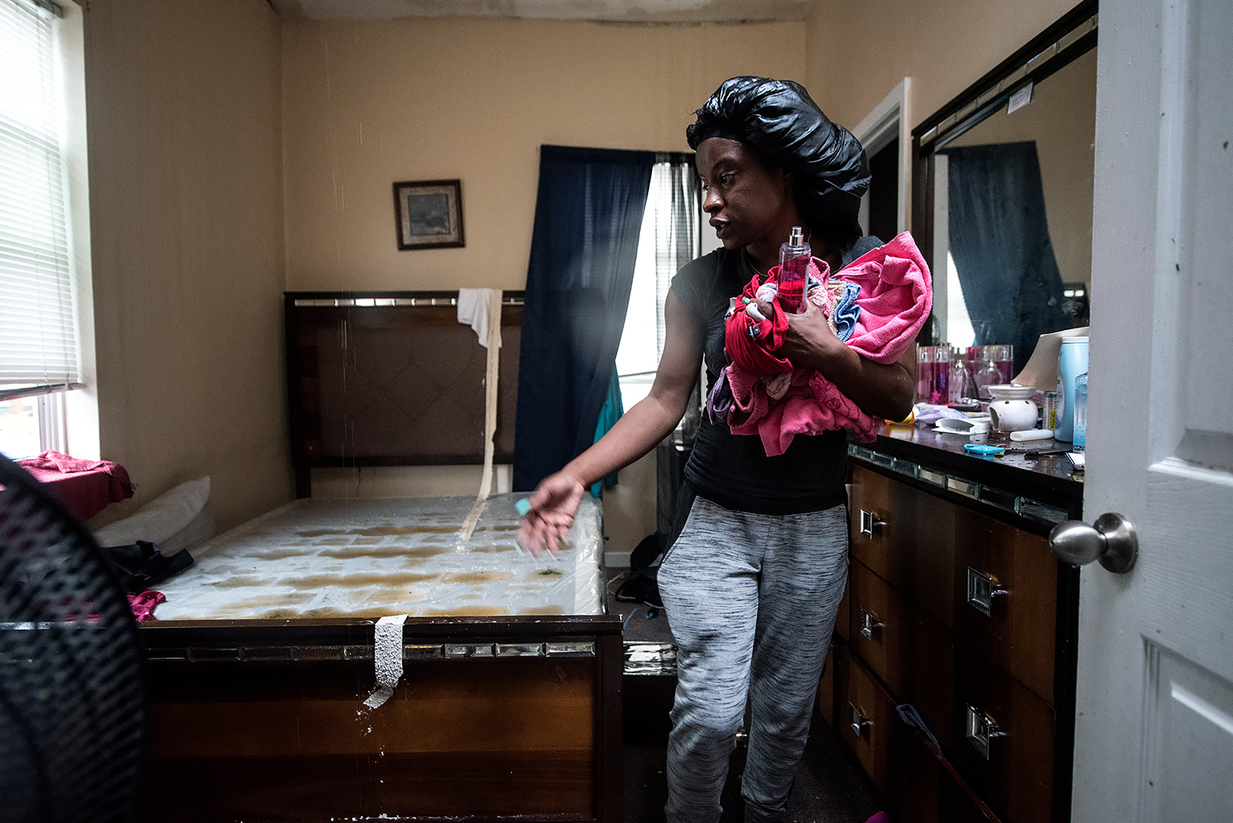 Rochel Williams returns to her home to gather belongings on Friday after the family's front porch collapsed and roof flew off earlier in the morning as Hurricane Florence made landfall.