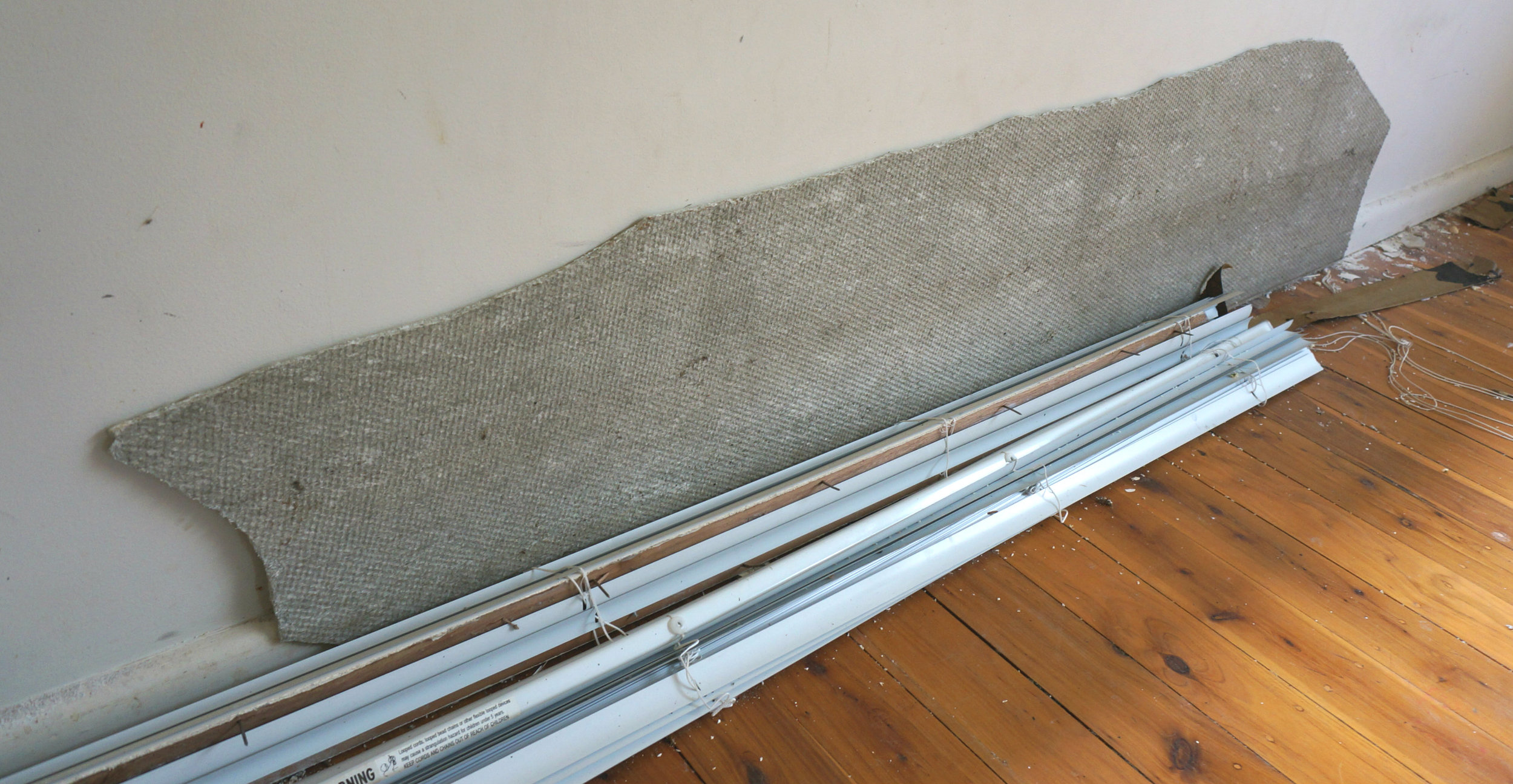 Fibro boards like these contain asbestos and are usually hidden between wood and plaster.