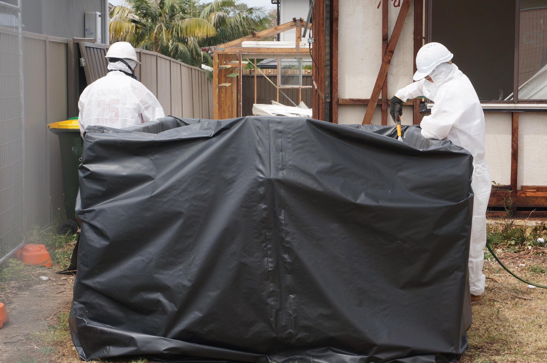 Hosing down asbestos boards