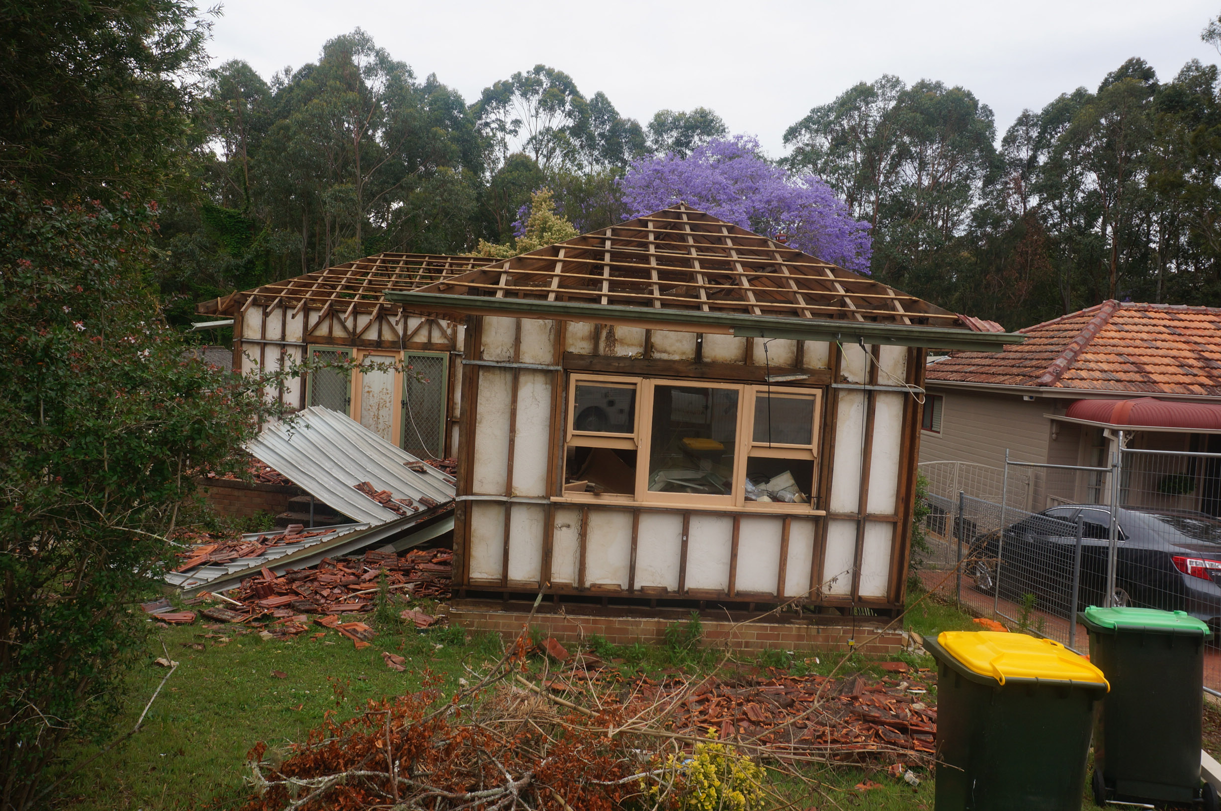 Once the asbestos had been removed, this (formerly) asbestos clad fibro home took around 20 minutes to demolish.
