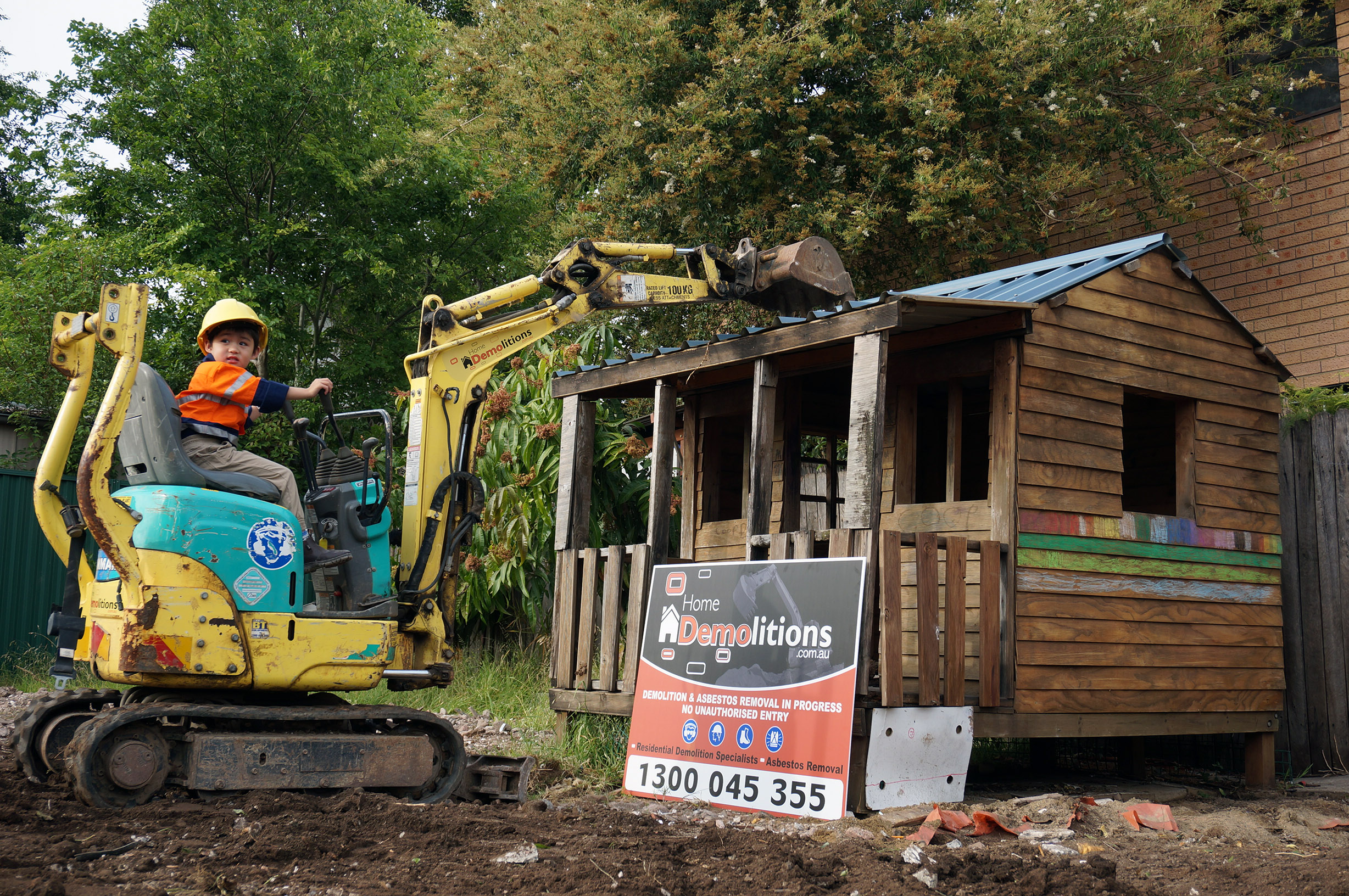 The youngest member of the Home Demolitions team hard at work!