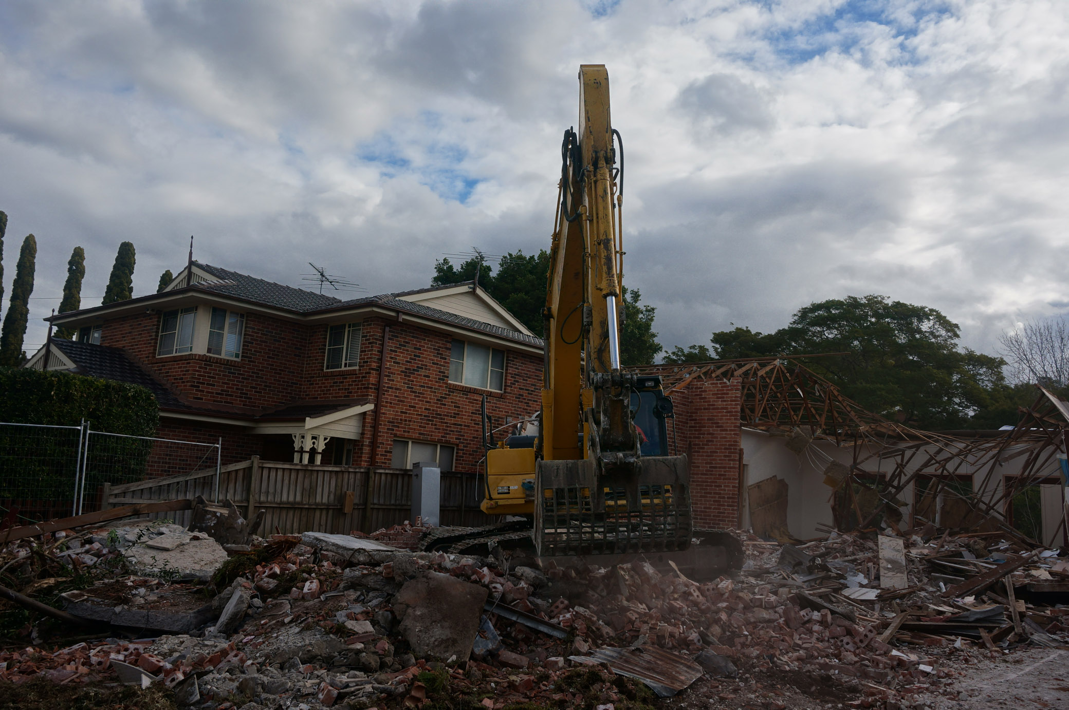 Clearing rubble with an excavator at demoliton site in West Ryde.jpg