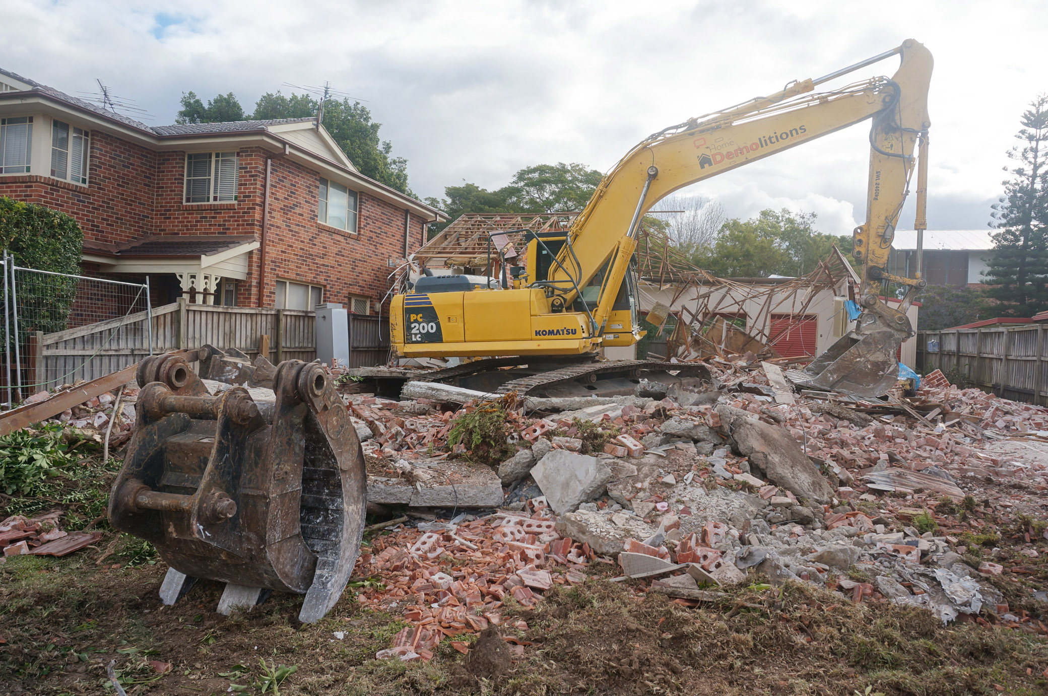Excavator amongst rubble at demolition site in West ryde.jpg