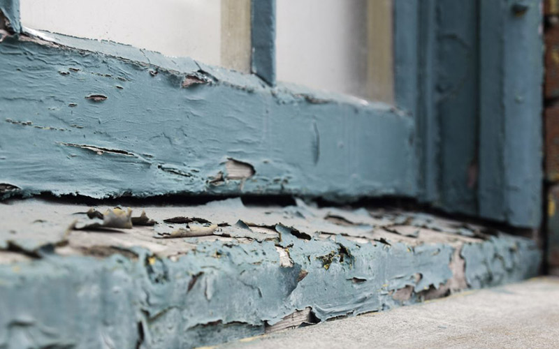 Cracking lead paint on a window sill