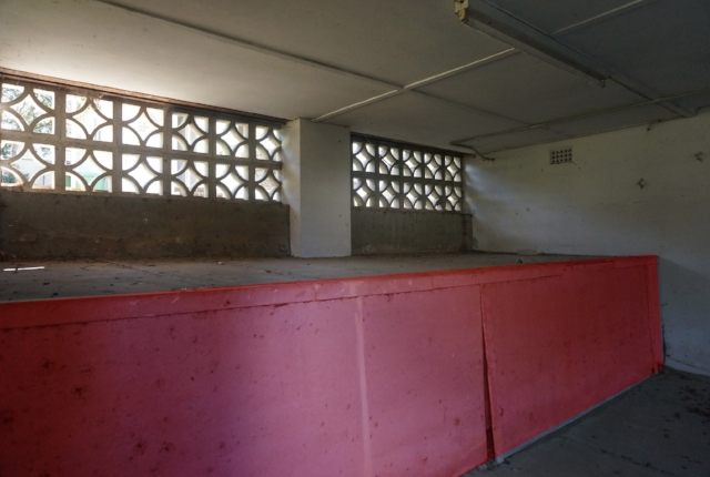 Asbestos highlighted in red found in a house set for demolition.