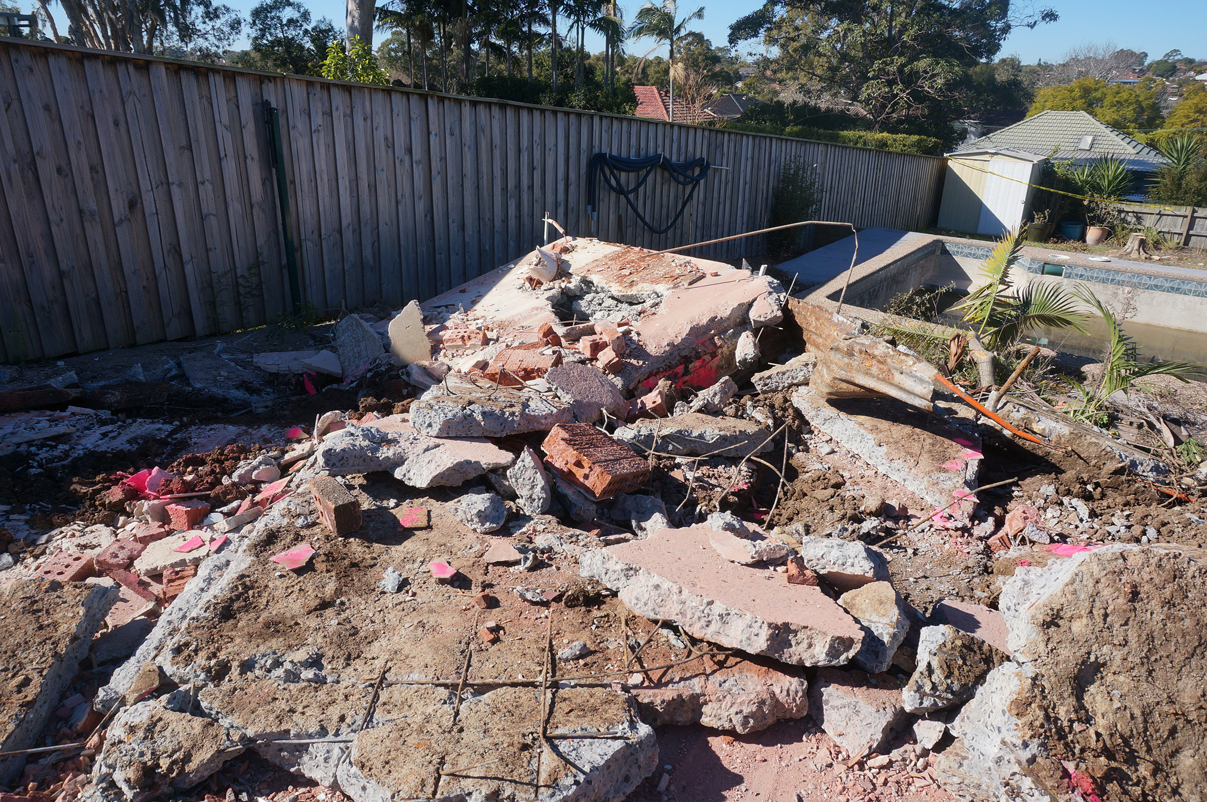 Asbestos uncovered when removing slab foundation.