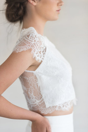 A lovely little lace top with raglan sleeves and a fun and flirty back
