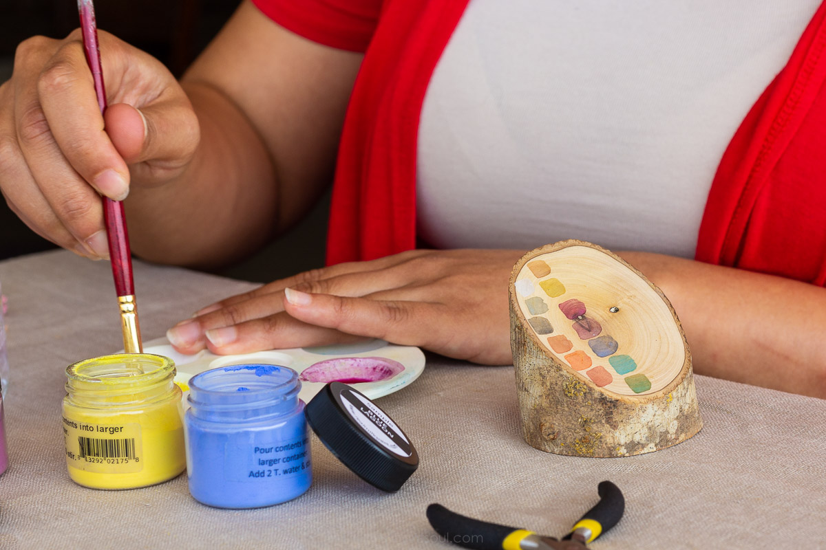 Photo of the artist Anabelle Colon from  Anabelle Colon Jewelry . At her home studio, she taught me how she colors each handmade jewelry item with non-toxic paints.