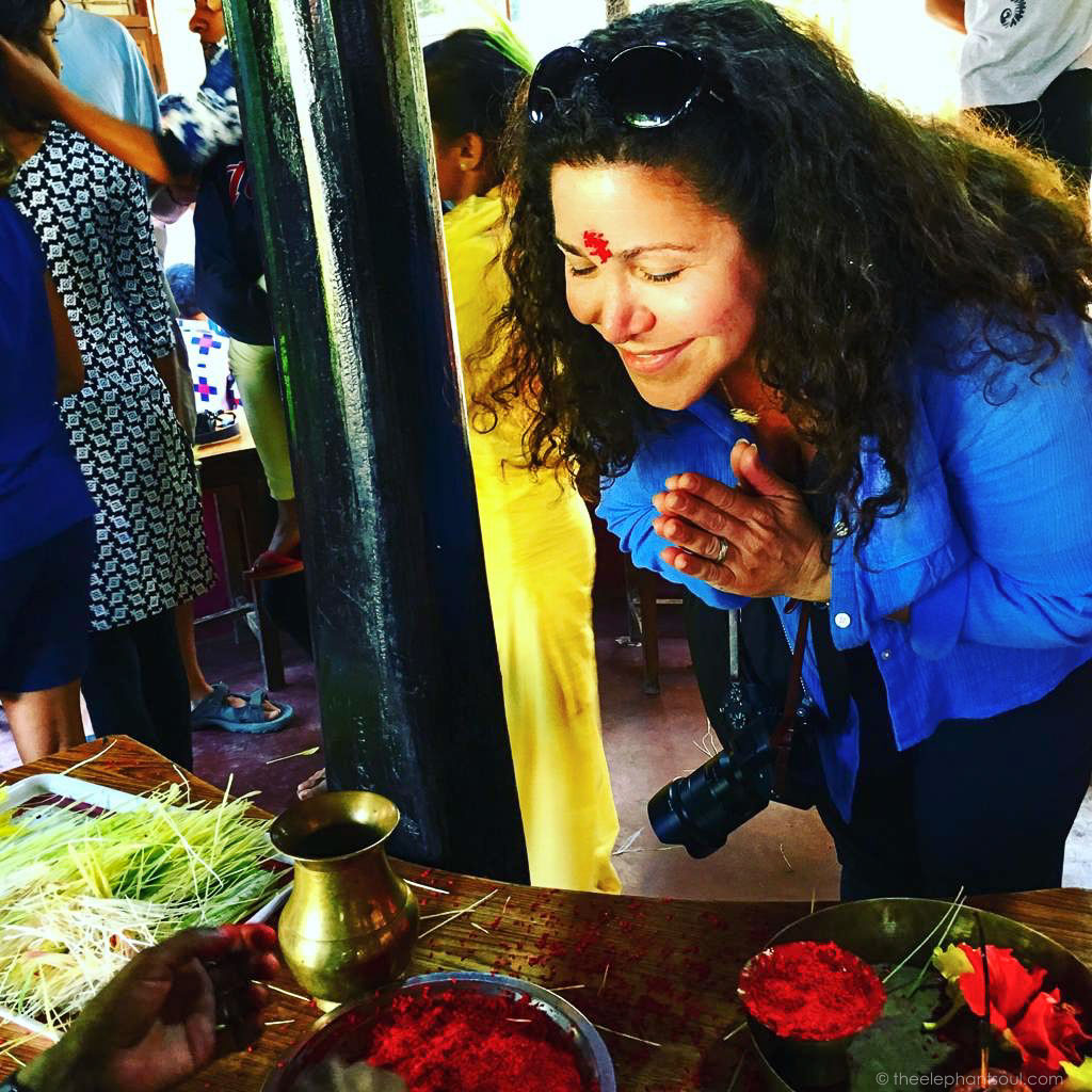 Monique receiving a blessing at a Hindu ceremony in Nepal.