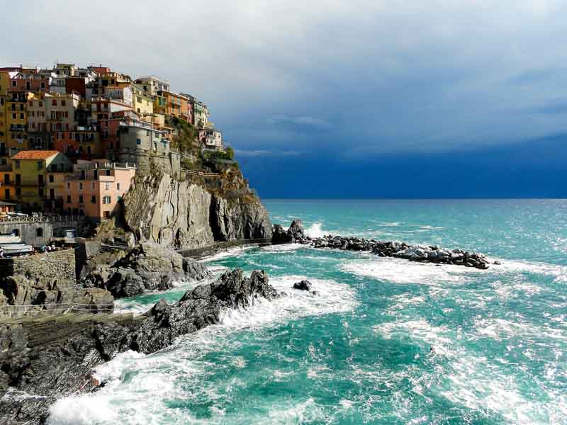 This is a dramatic view of Manarola in Cinque Terre, Italy. I took this camera with my small point and shoot camera.