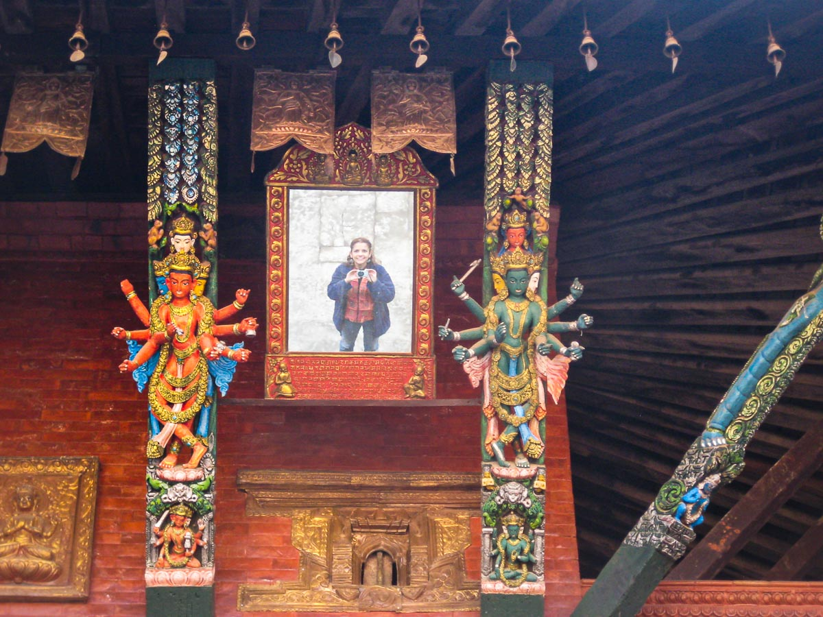 Juanita's image is reflected in the mirror at one of the sacred Hindu temples in Kathmandu, Nepal.