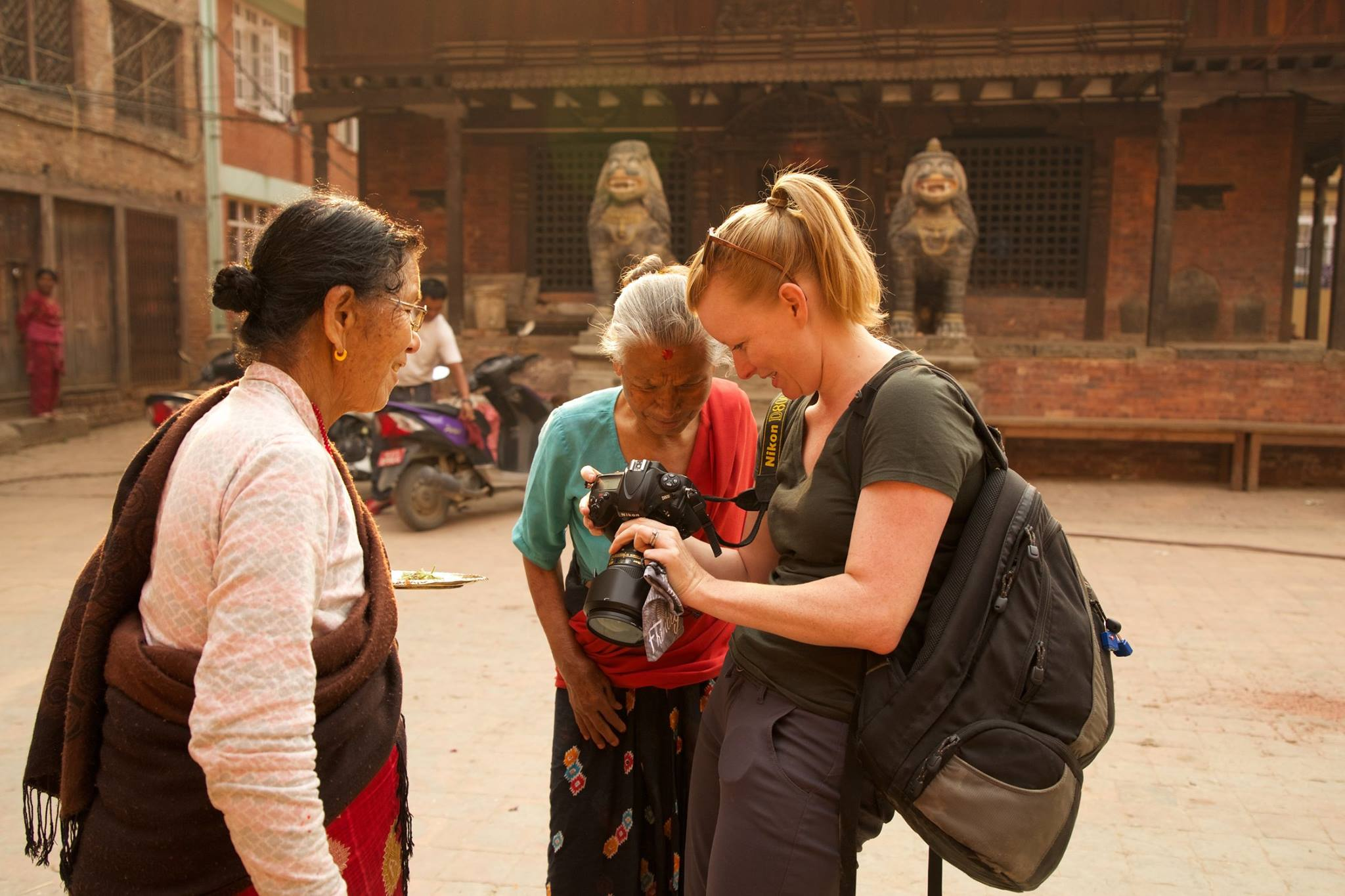 Pictured here, photographer and filmmaker Crystaline Randazzo at one of her photo outings in Kathmandu, Nepal. Photo credit ©Monique Kovacs Nathan