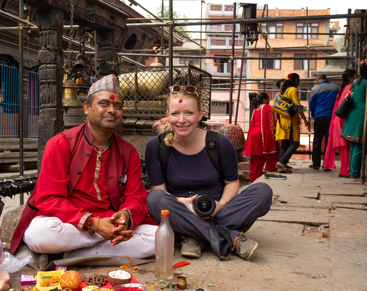 Photographer Crystaline Randazzo receiving a blessing from a Hindu priest in the old kingdom of Lalitpur in Kathmandu, Nepal. Photo credit © D. Argueta from The Elephant Soul.