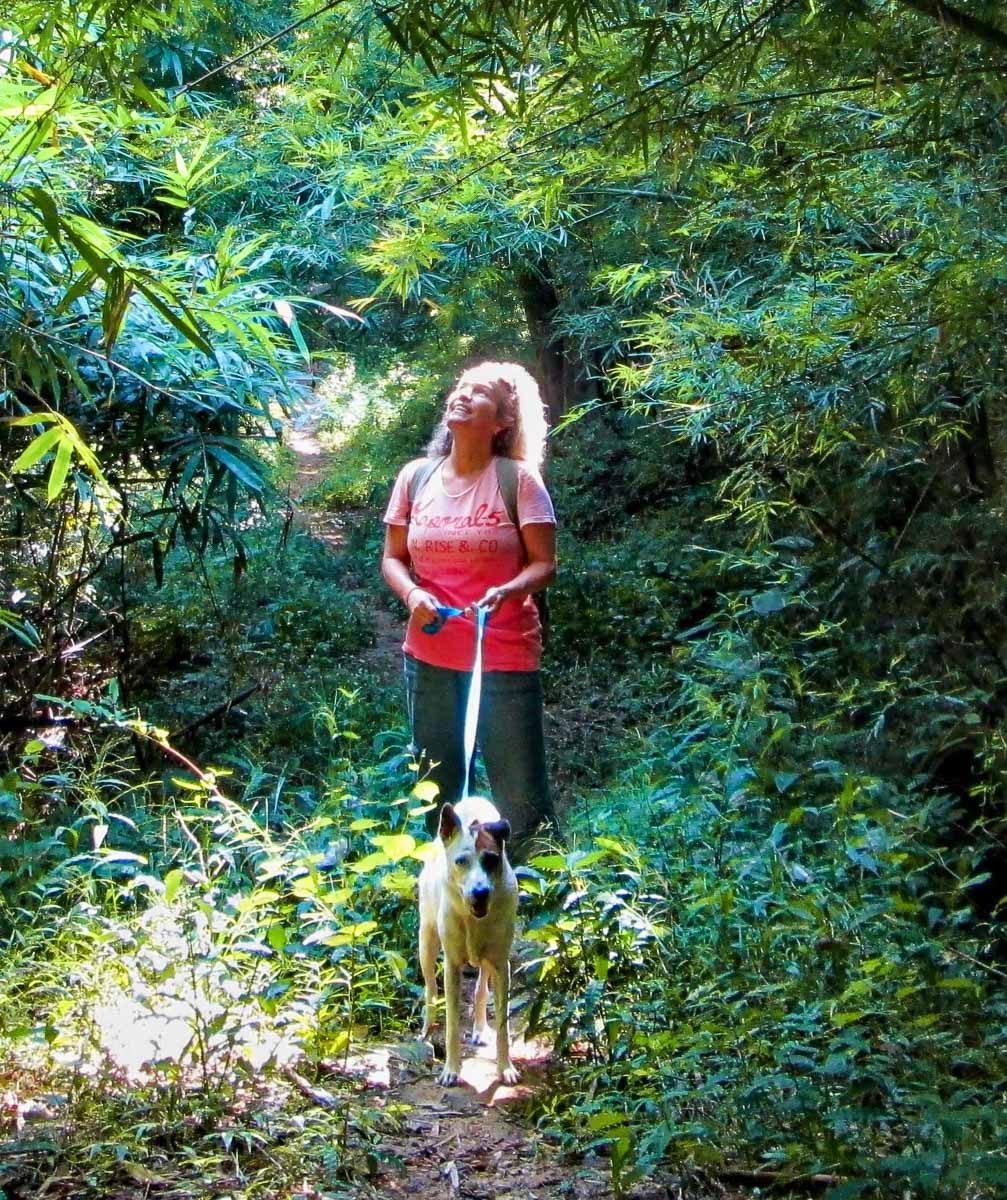 Pictured here, Lena and her dog also named Lucky during a walk in the forest. © Image: Lena Quénard